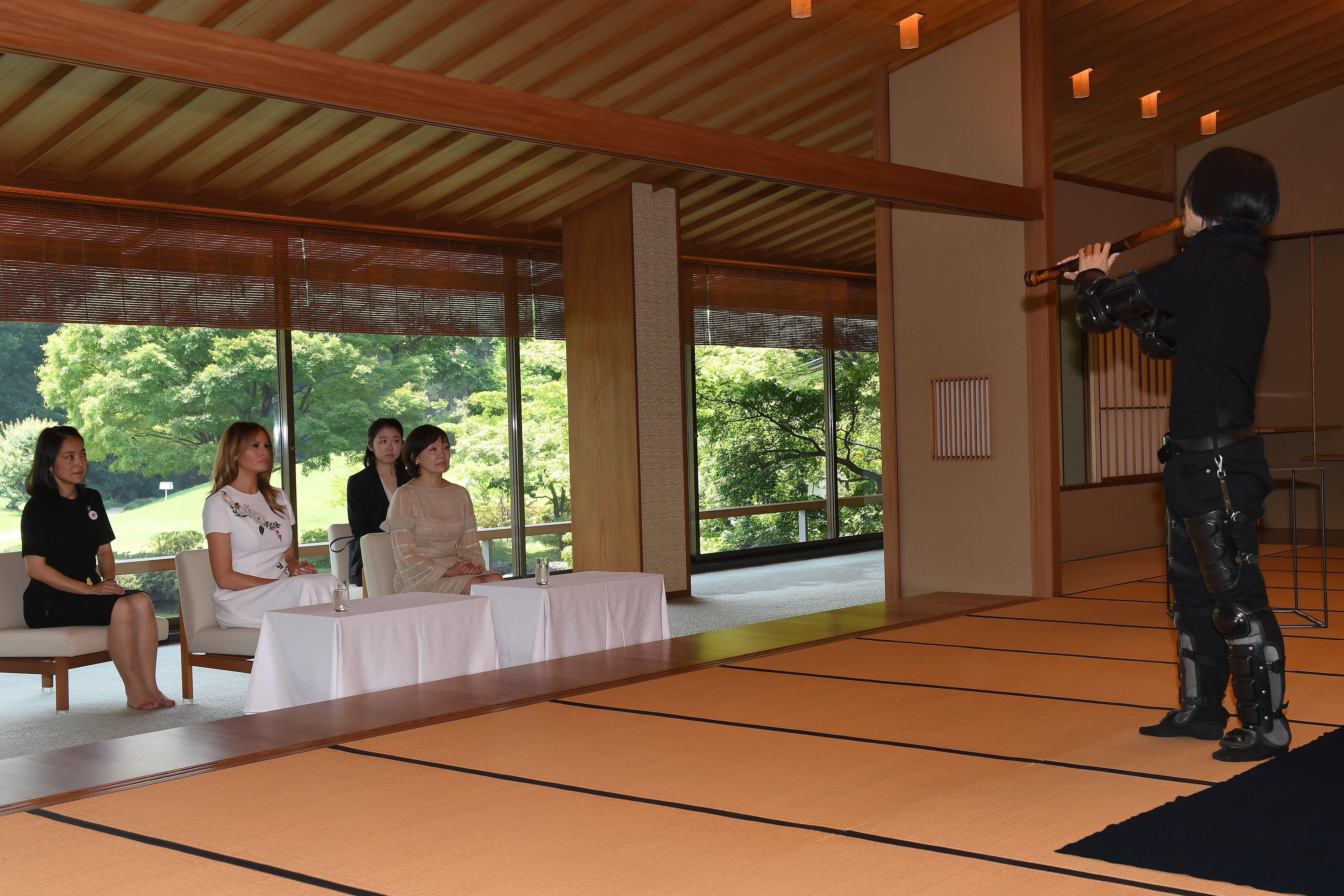 US First Lady Melania Trump (L) and Japan's Premier Shinzo Abe's wife Akie watch an artist play a traditional shakuhachi, bamboo-flute, in a Japanese style annex at Akasaka guest house in Tokyo on May 27, 2019. (Photo by TOSHIFUMI KITAMURA/AFP/Getty Images)