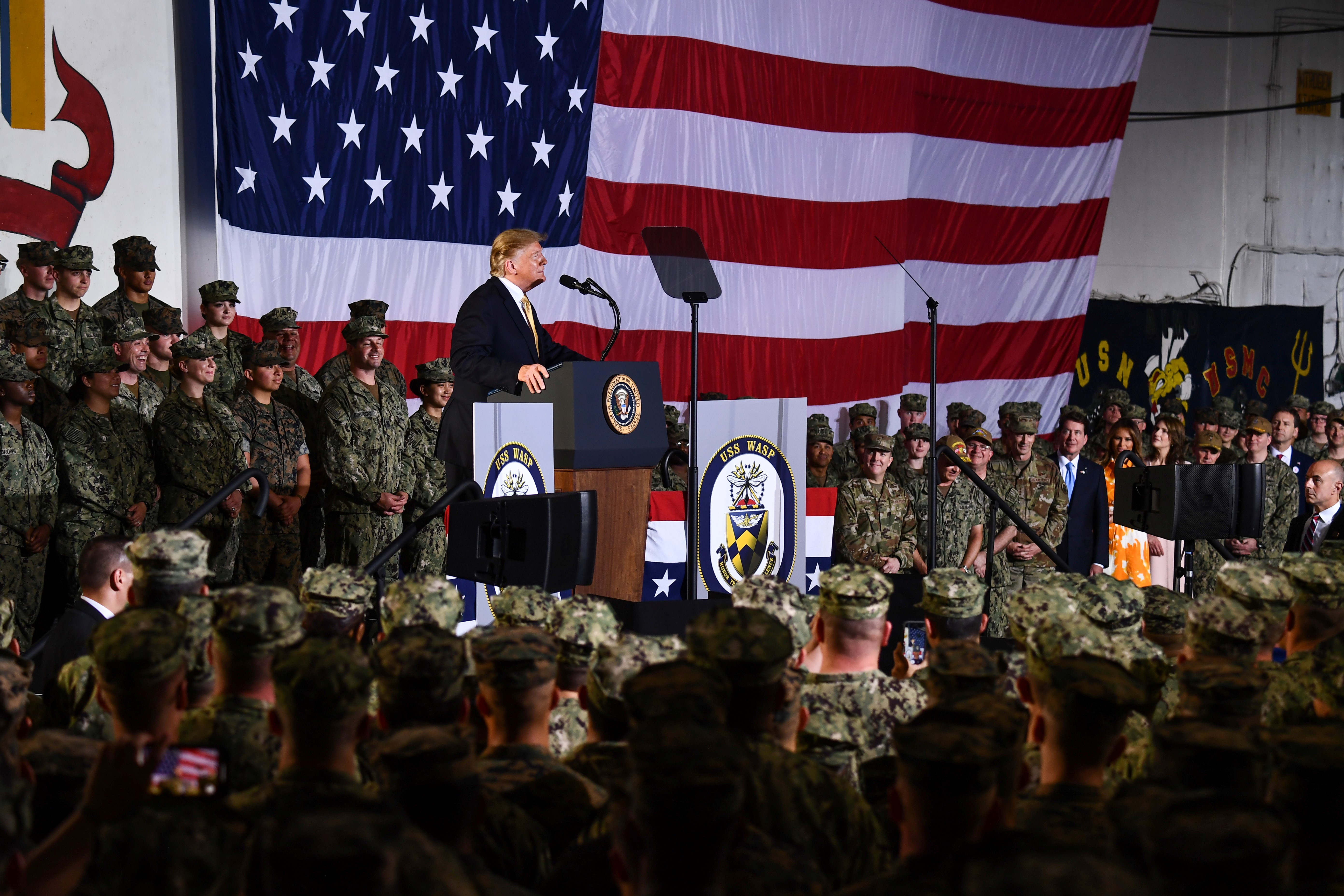 US President Donald Trump speaks during a Memorial Day event aboard the amphibious assault ship USS Wasp (LHD 1) in Yokosuka on May 28, 2019. (Photo by BRENDAN SMIALOWSKI/AFP/Getty Images)