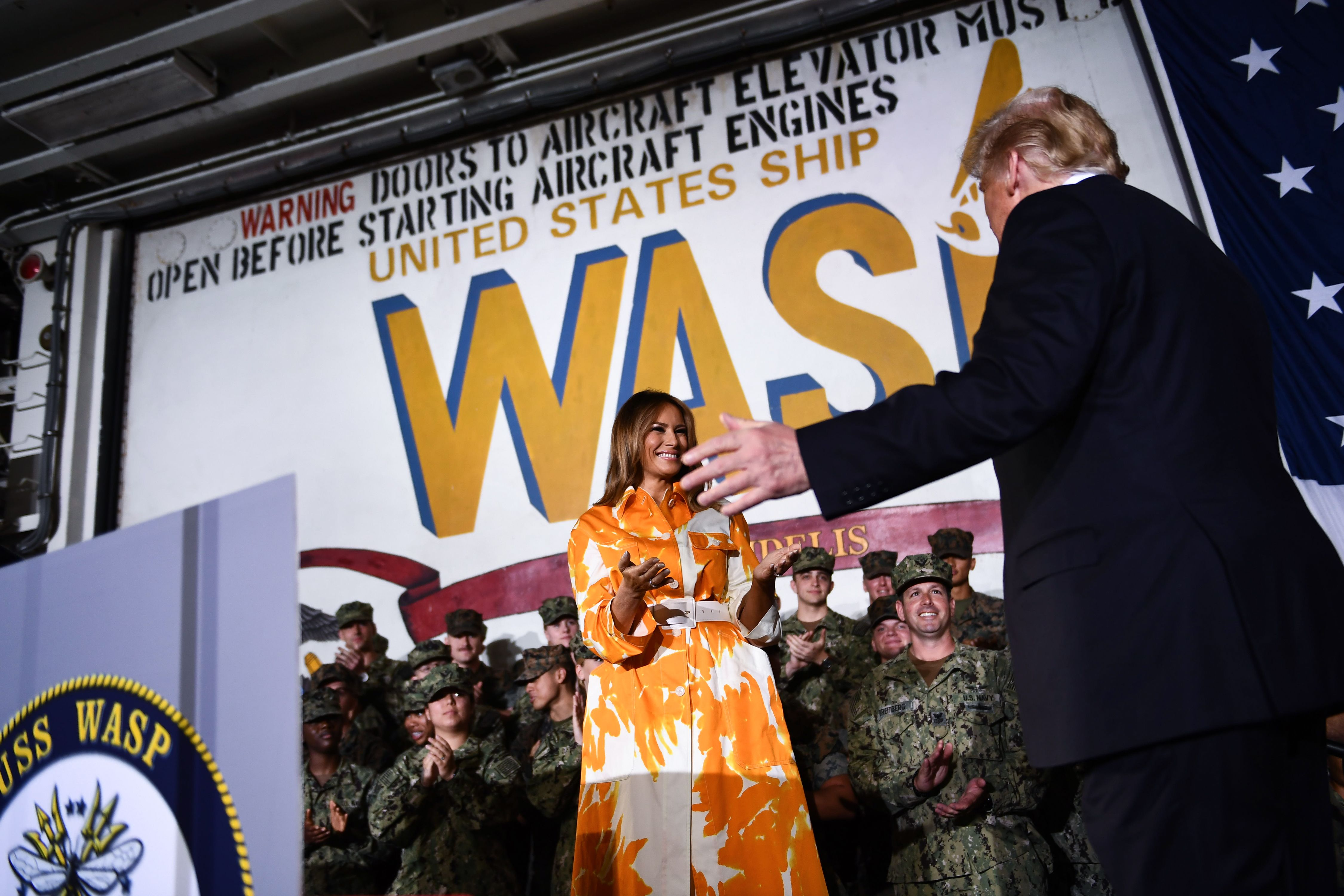 US President Donald Trump and First Lady Melania Trump arrive on stage during a Memorial Day event aboard the amphibious assault ship USS Wasp (LHD 1) in Yokosuka on May 28, 2019. (Photo by BRENDAN SMIALOWSKI/AFP/Getty Images)