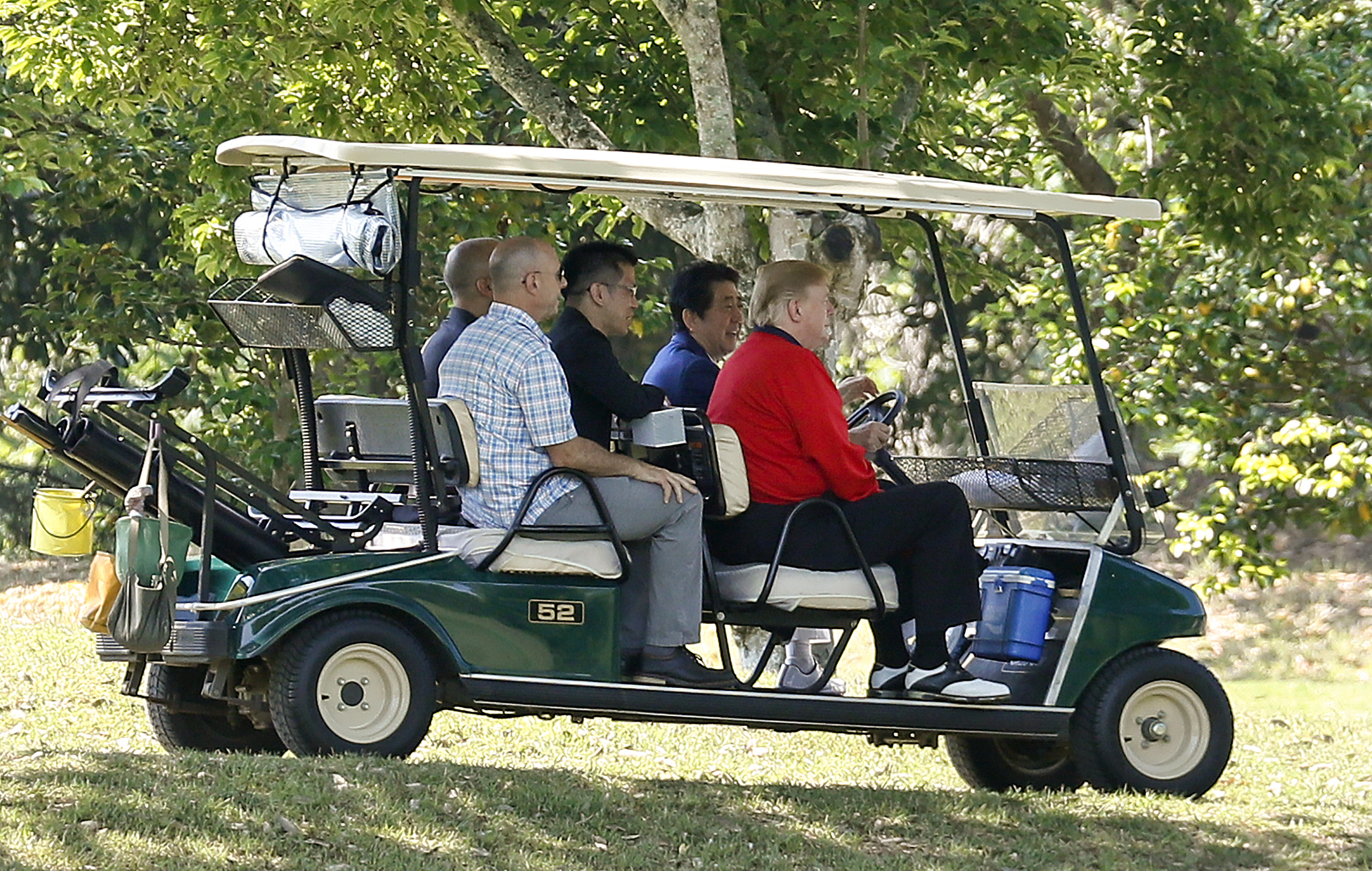 CHIBA, JAPAN - MAY 26: U.S. President Donald Trump (R) sits in the golf cart as Japanese Prime Minister Shinzo Abe (2-R) drives while playing golf at Mobara Country Club on May 26, 2019 in Chiba, Japan. U.S. President Donald Trump is on a four-day state visit to Japan, the first official visit of the Reiwa era. Alongside a number of engagements, Trump is expected to watch a sumo match, attend an imperial banquet with newly-enthroned Emperor Naruhito and meet with families of North Korean abductees. (Photo by Kimimasa Mayama - Pool/Getty Images)