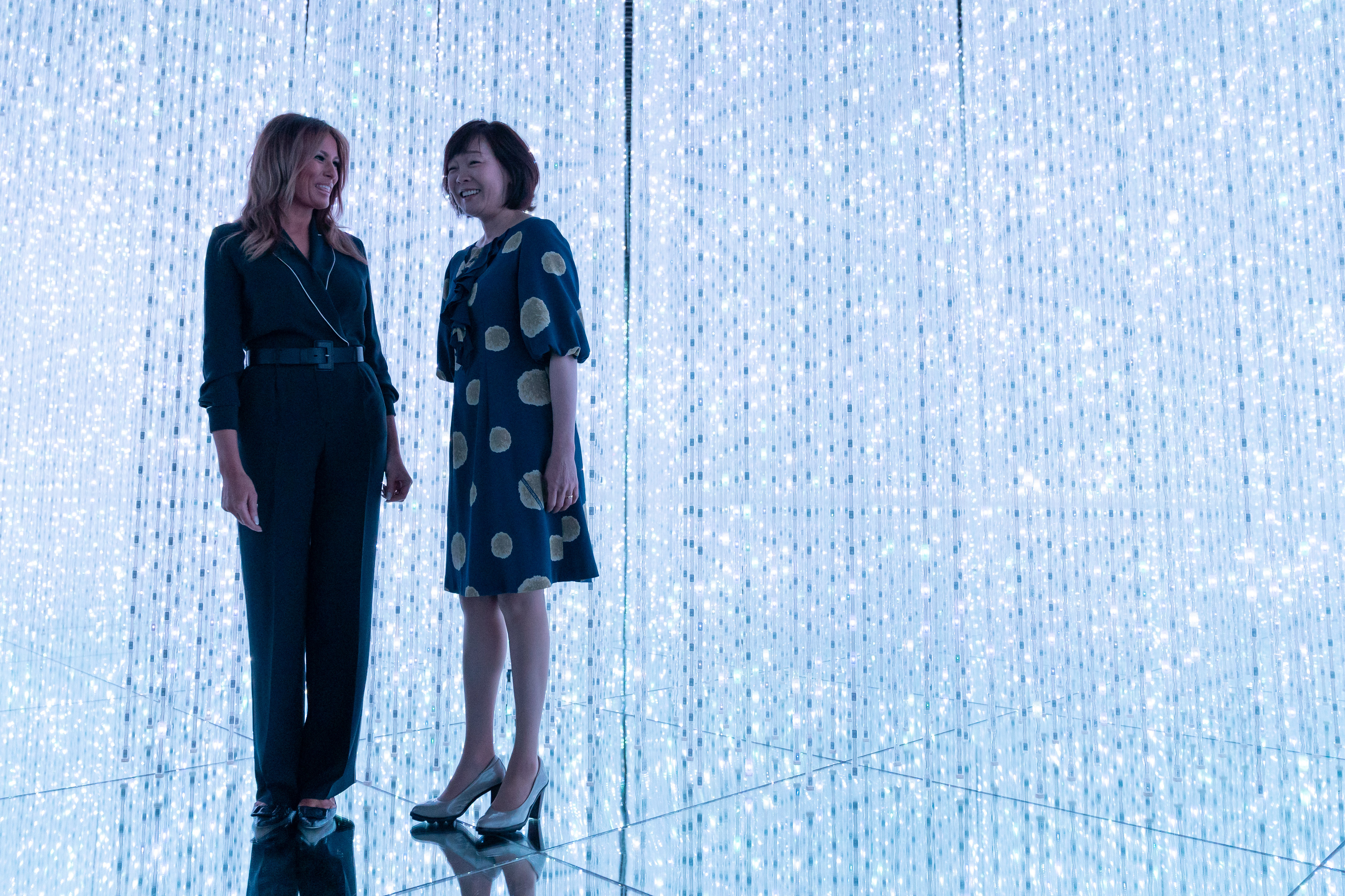 TOKYO, JAPAN - MAY 26: Japan's Prime Minister Shinzo Abe's wife Akie Abe (R) and U.S. first Lady Melania Trump (L) visit the MORI Building DIGITAL ART MUSEUM on May 26, 2019 in Tokyo, Japan. (Photo by Pierre Emmanuel Deletree - Pool/Getty Images)