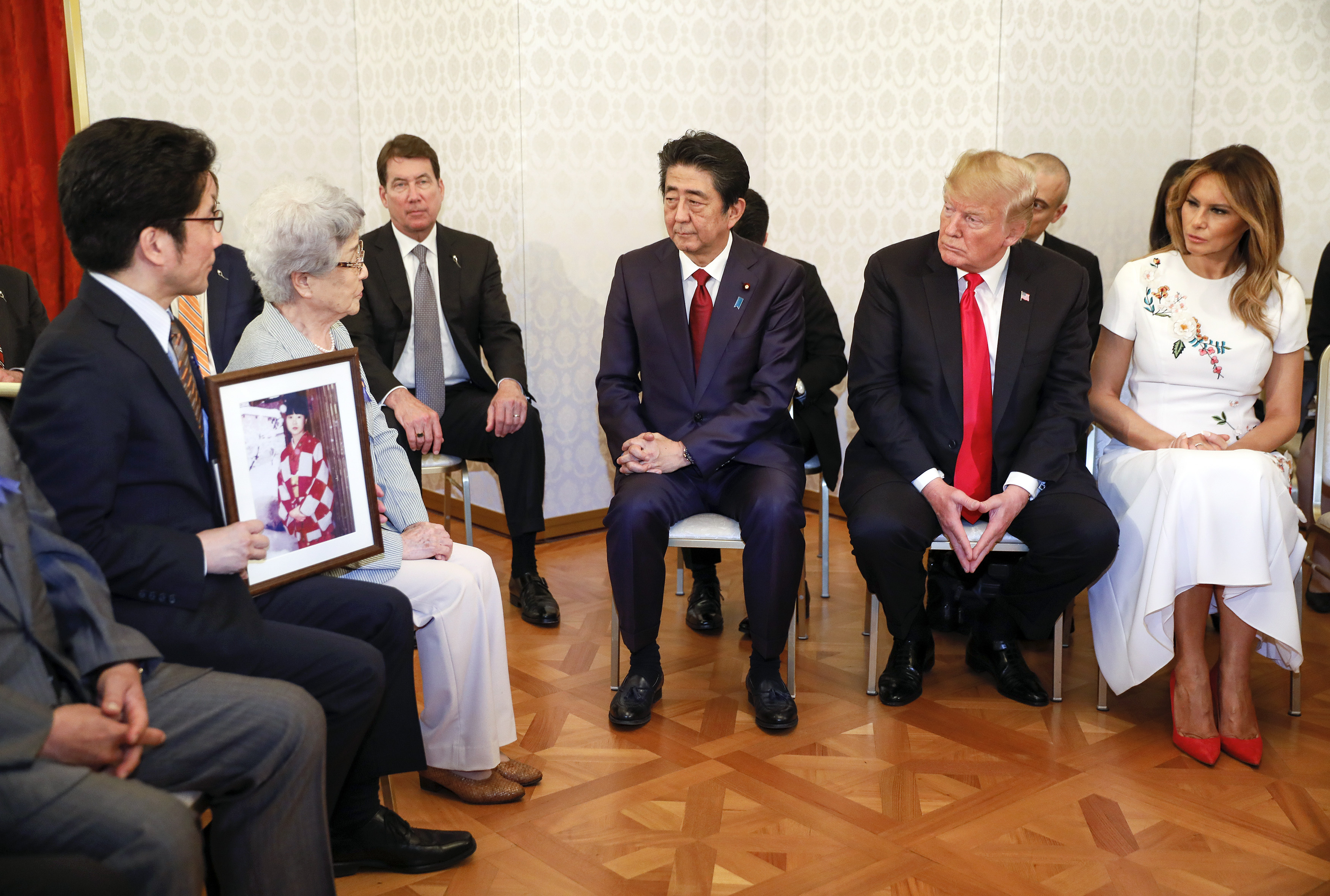 TOKYO, JAPAN - MAY 27: US President Donald Trump listens to Sakie Yokota (2-L), the mother of Megumi who was kidnapped by North Korean agents at the age of 13 in 1977, as he meets the families of Japanese abductees by North Korea with First Lady Melania (R), Japanese Prime Minister Shinzo Abe (C) at Akasaka State Guesthouse on May 27, 2019 in Tokyo, Japan. (Photo by Kimimasa Mayama - Pool/Getty Images)