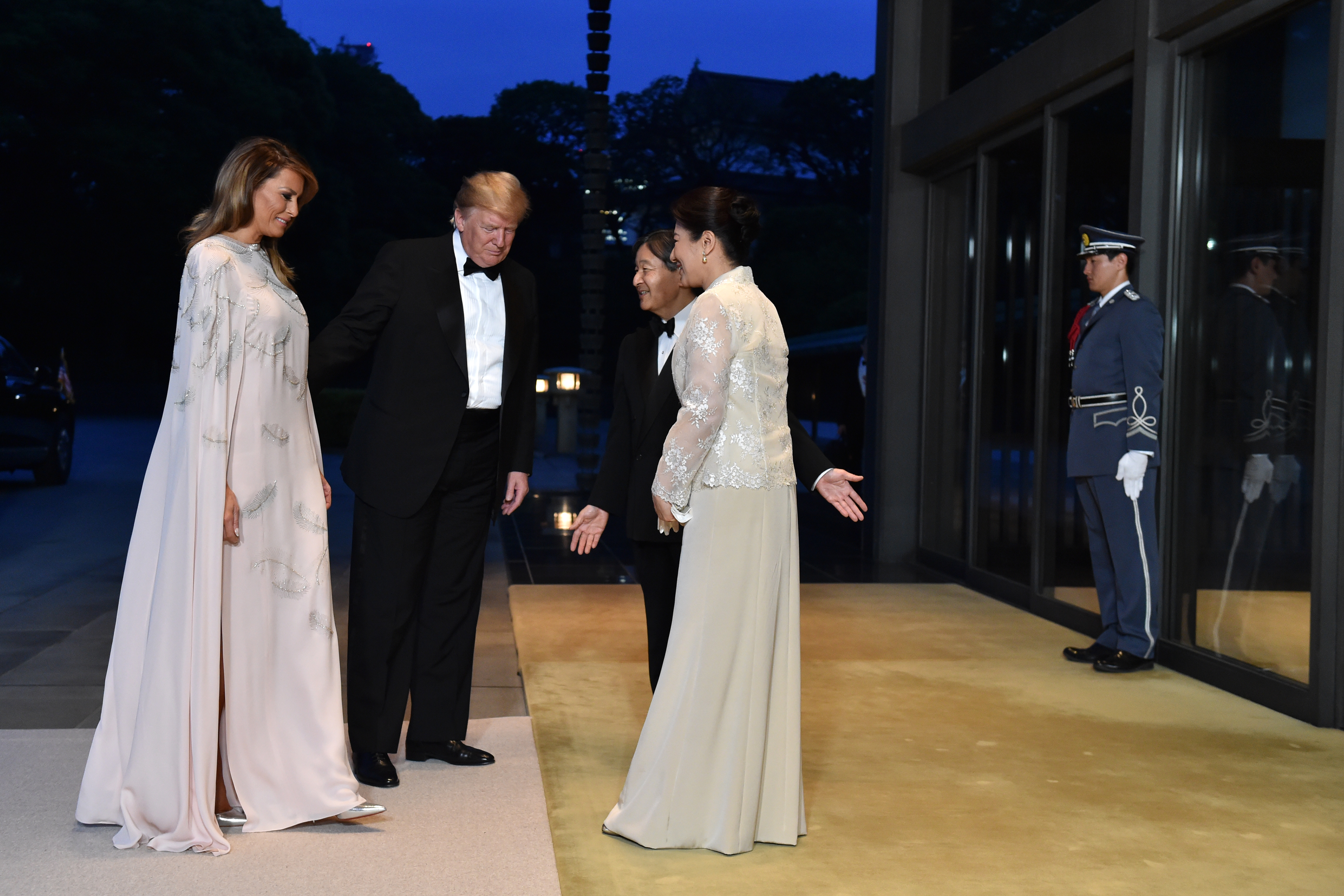 TOKYO, JAPAN - MAY 27: US President Donald Trump (2nd L) and First Lady Melania Trump (L) are greeted by Japan's Emperor Naruhito and Empress Masako upon their arrival at the Imperial Palace for a state banquet on May 27, 2019 in Tokyo, Japan. (Photo by Kazuhiro Nogi - Pool/Getty Images)