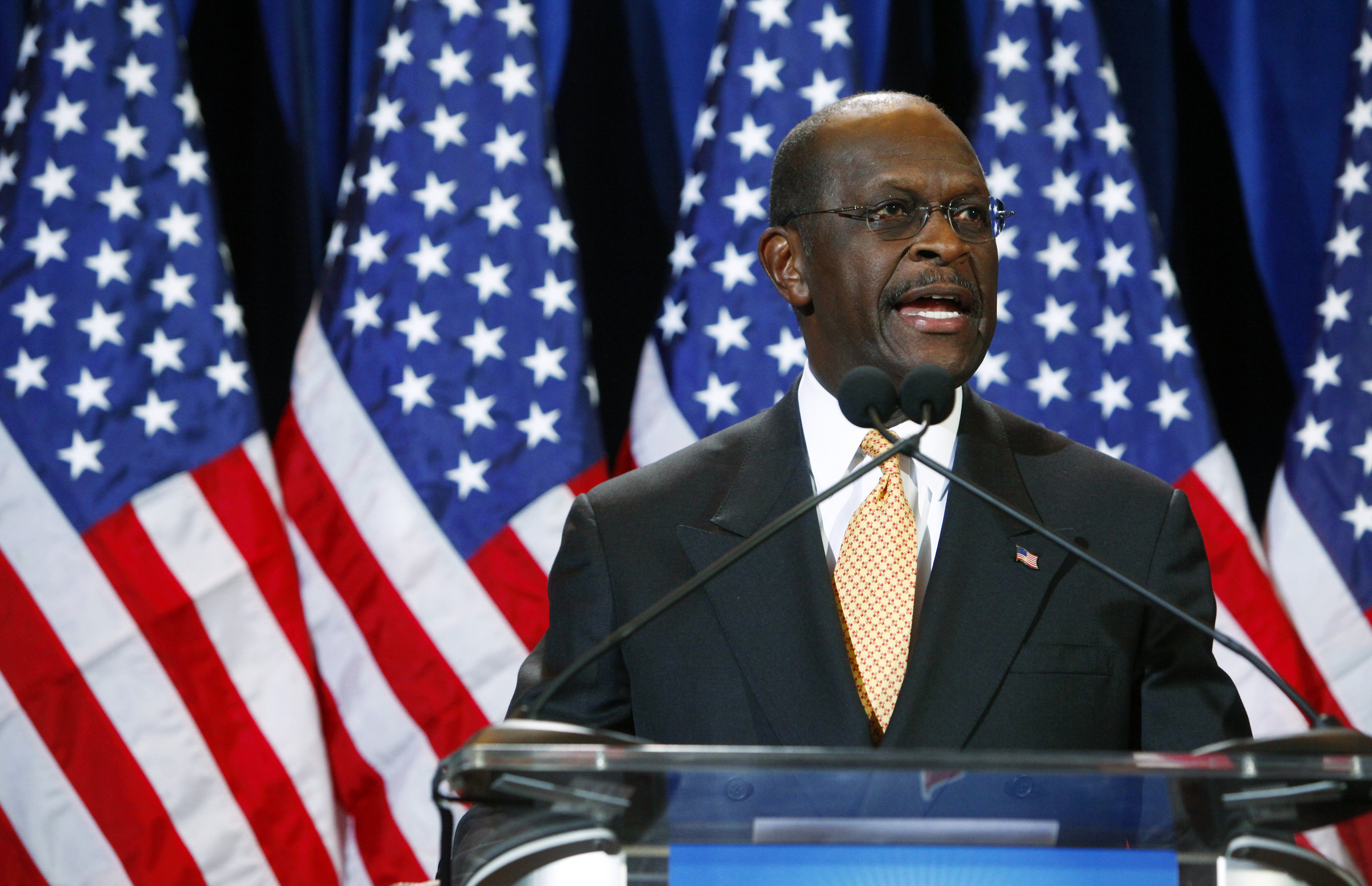 Republican presidential candidate and former Godfather's Pizza CEO Herman Cain speaks at a press conference November 8, 2011 in Scottsdale, Arizona. Cain is facing pressure after a fourth woman came forward Monday to accuse Cain of inappropriate behavior when he was while CEO of the National Restaurant Association. (Photo by Eric Thayer/Getty Images)
