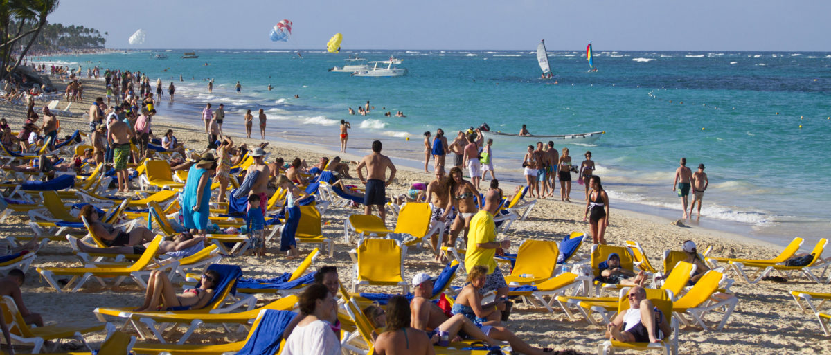 Tourists rest at Bavaro beach, in Punta Cana, Dominican Republic, on January 16, 2012. Tourism is the main industry in Dominican Republic, and Punta Cana is one of the leading tourist destinations in the Caribbean. (Photo: ERIKA SANTELICES/AFP/Getty Images)