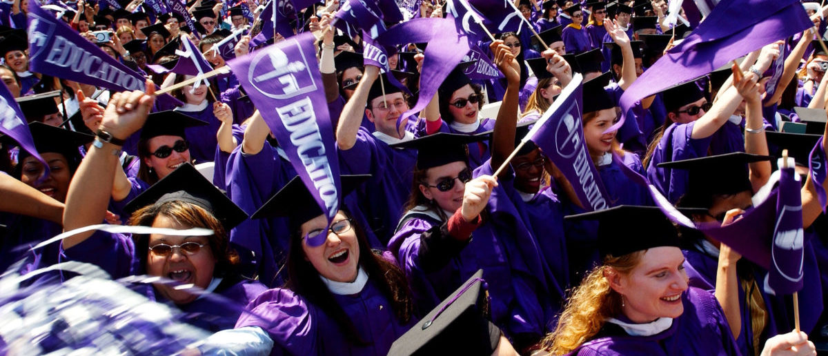 Graduating students celebrate during commencement exercises May 16, 2002 at New York University in New York City. (Spencer Platt/Getty Images)