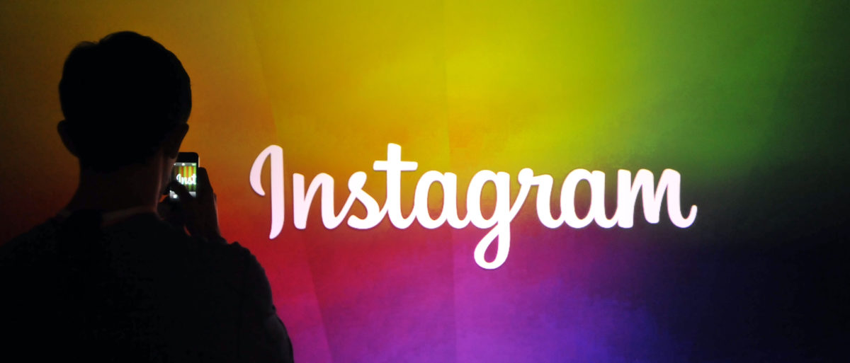 An Instagram employee takes a video using Instagram's new video function at Facebook's corporate headquarters during a media event in Menlo Park, California on June 20, 2013. (Photo: Josh Edelson/AFP/Getty Images)