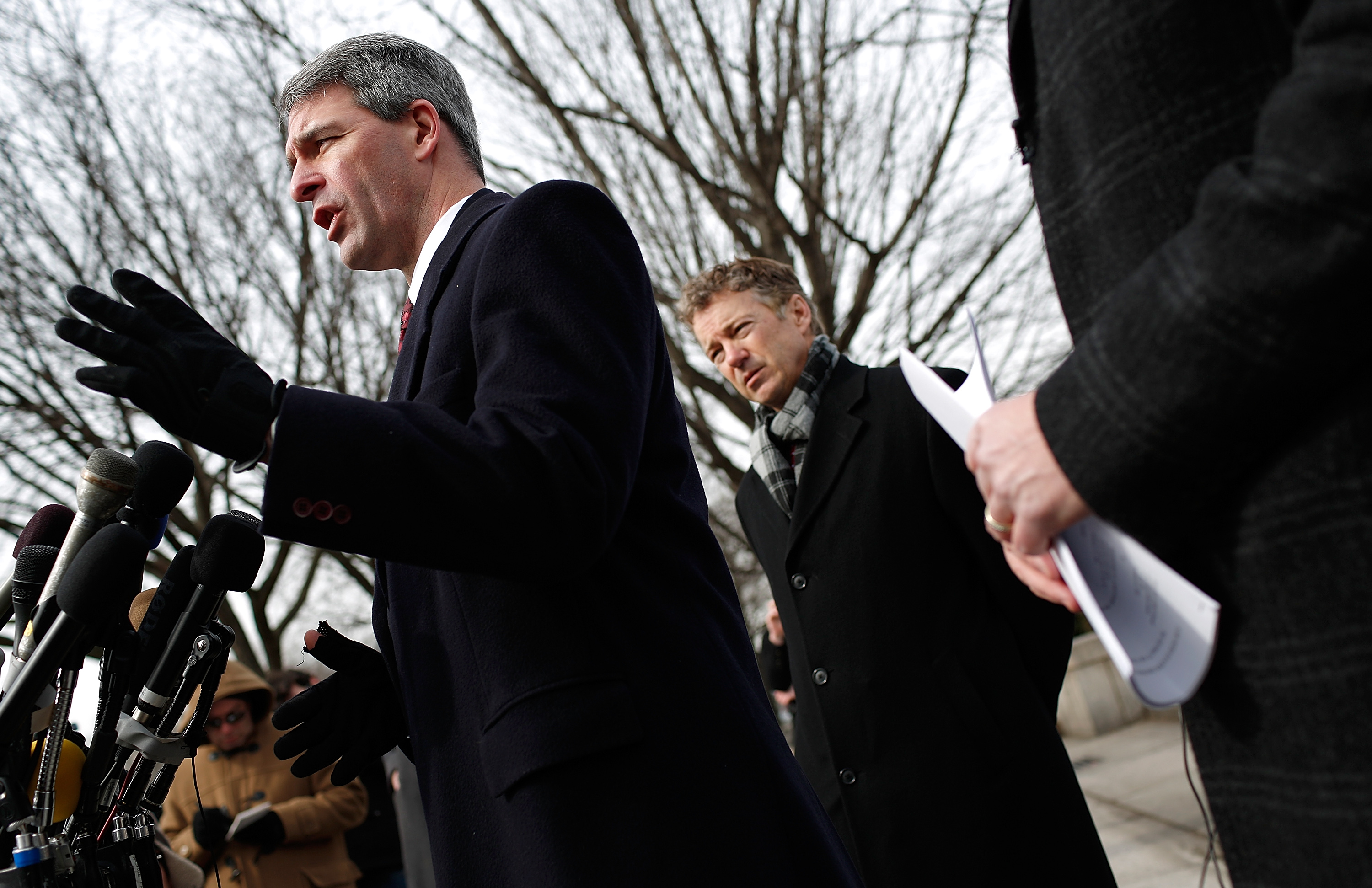 WASHINGTON, DC - FEBRUARY 12: Former Virginia Attorney General Ken Cuccinelli (L) and U.S. Sen. Rand Paul (R-KY) speak at a press conference in front of U.S. District Court to announce the filing of a class action lawsuit against the administration of U.S. President Barack Obama, Director of National Intelligence James Clapper, National Security Agency Director Keith Alexander and FBI Director James Comey. Paul said he filed the lawsuit to stop NSA surveillance of U.S. phone records because Obama has Òpublicly refused to stop a clear and continuing violation of the 4th amendment.Ó (Photo by Win McNamee/Getty Images)