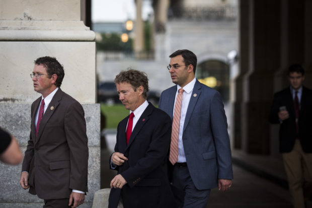 WASHINGTON, DC - MAY 31: (L - R) Rep. Thomas Massie (R-KY), Sen. Rand Paul (R-KY) and Rep. Justin Amash (R-MI) exit the Senate chamber after Paul spoke about surveillance legislation on the Senate floor, on Capitol Hill, May 31, 2015 in Washington, DC. The National Security Agency's authority to collect bulk telephone data is set to expire June 1, unless the Senate can come to an agreement to extend the surveillance programs. (Photo by Drew Angerer/Getty Images)