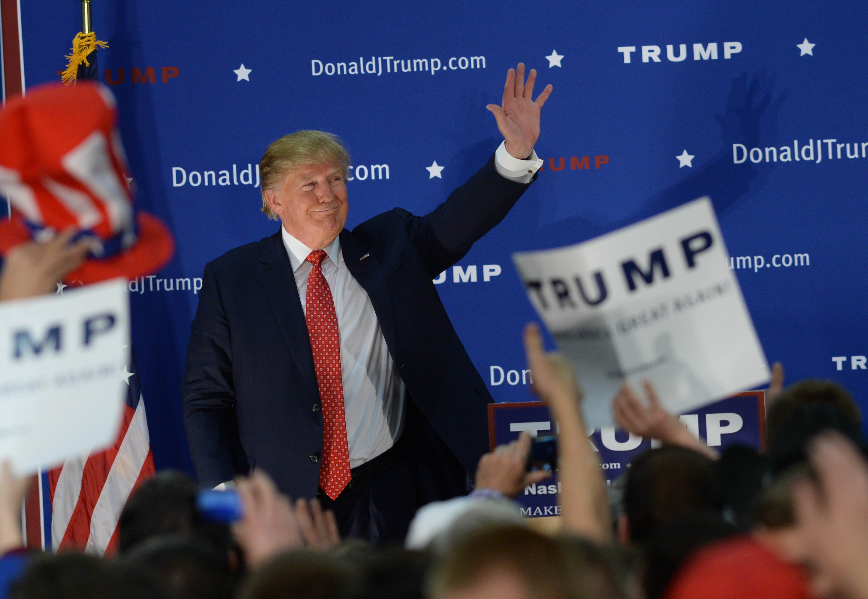 Republican Presidential candidate Donald Trump waves to the crowd after speaking at a rally at Pennichuck Middle School December 28, 2015 in Nashua, New Hampshire. (Photo by Darren McCollester/Getty Images)