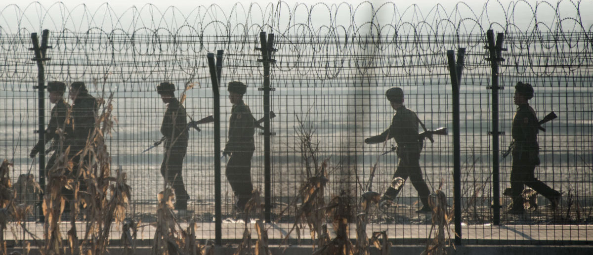 North Korean soldiers patrol next to the border fence near the town of Sinuiju across from the Chinese border town of Dandong on February 10, 2016. (JOHANNES EISELE/AFP/Getty Images)