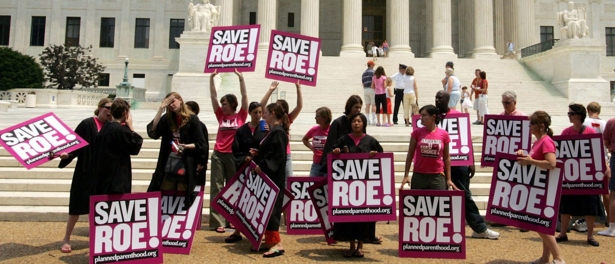 Members of Planned Parenthood protests in front of the Supreme Court on the day that Sandra Day O'Connor, the first woman on the Supreme Court and a swing vote on abortion, announced her retirement July 1, 2005 in Washington, DC. (Joe Raedle/Getty Images)