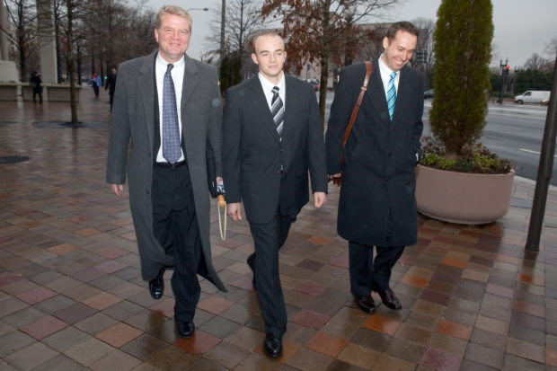 Former Blackwater security guard Nick Slatten (C) and his lawyer Thomas Connolly (L) leave an arraignment hearing at U.S. district court on January 6, 2009 in Washington, DC.(Brendan Hoffman/Getty Images)