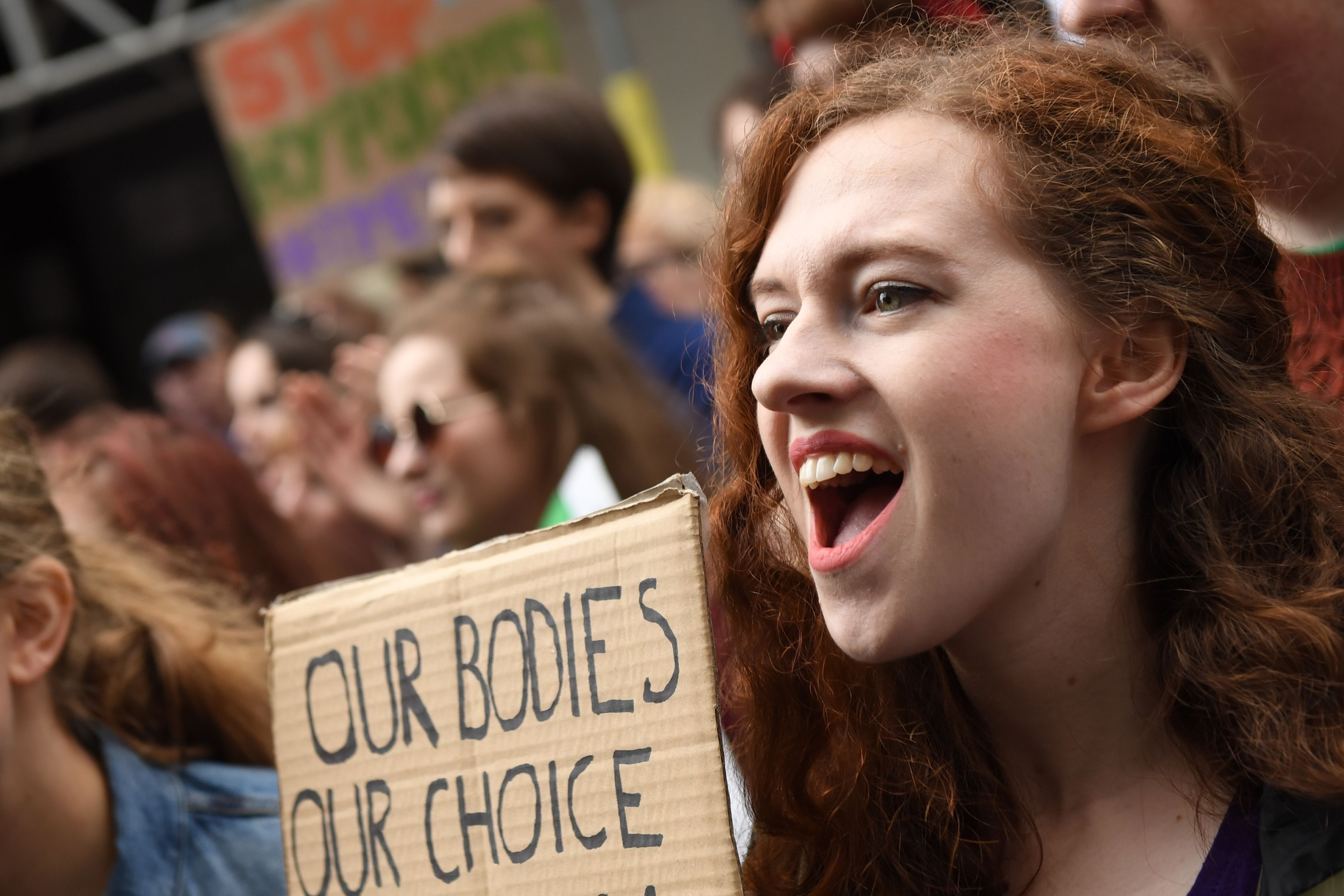 Protesters hold up placards during the London March for Choice, calling for the legalising of abortion in Ireland after the referendum announcement, outside the Embassy of Ireland in central London on September 30, 2017.