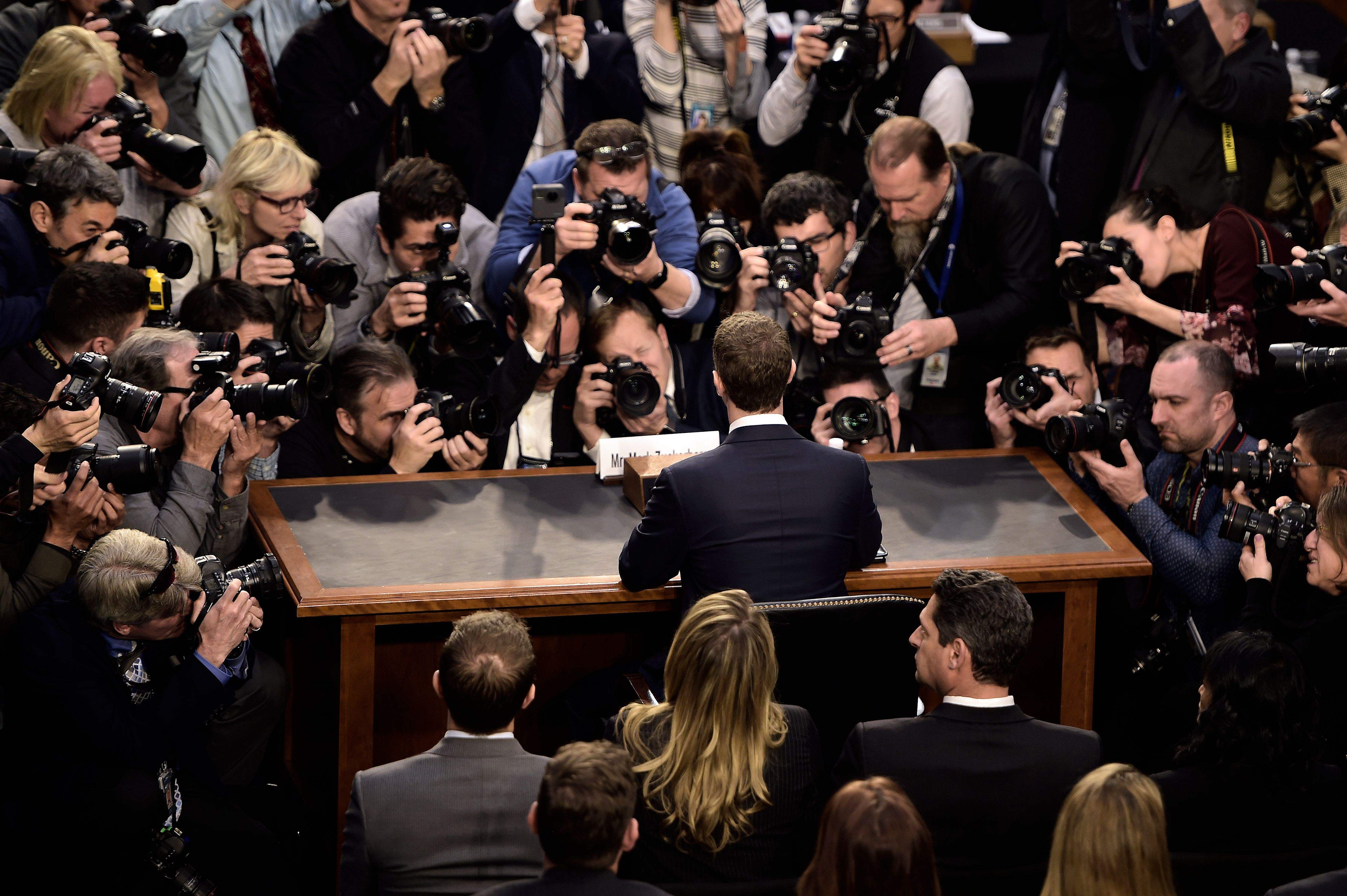 TOPSHOT - Facebook CEO Mark Zuckerberg arrives to testify before a joint hearing of the US Senate Commerce, Science and Transportation Committee and Senate Judiciary Committee on Capitol Hill, April 10, 2018 in Washington, DC. Zuckerberg, making his first formal appearance at a Congressional hearing, seeks to allay widespread fears ignited by the leaking of private data on tens of millions of users to British firm Cambridge Analytica working on Donald Trump's 2016 presidential campaign. / AFP PHOTO / Brendan Smialowski (Photo credit should read BRENDAN SMIALOWSKI/AFP/Getty Images)