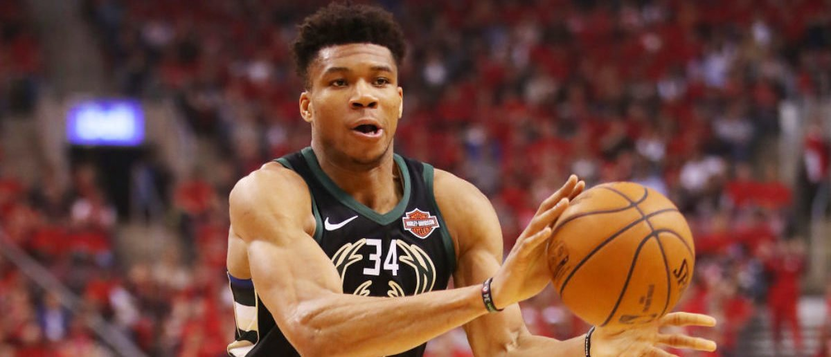 TORONTO, ONTARIO - MAY 25: Giannis Antetokounmpo #34 of the Milwaukee Bucks handles the ball during the first half against the Toronto Raptors in game six of the NBA Eastern Conference Finals at Scotiabank Arena on May 25, 2019 in Toronto, Canada. (Photo by Gregory Shamus/Getty Images)