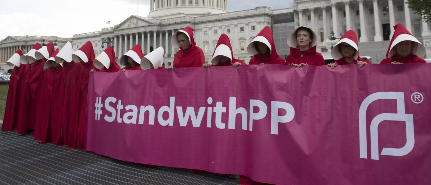 Supporters of Planned Parenthood hold a rally as they protest the Senate GOP healthcare bill outside the Capitol on June 27, 2017. (Saul Loeb/AFP/Getty Images)
