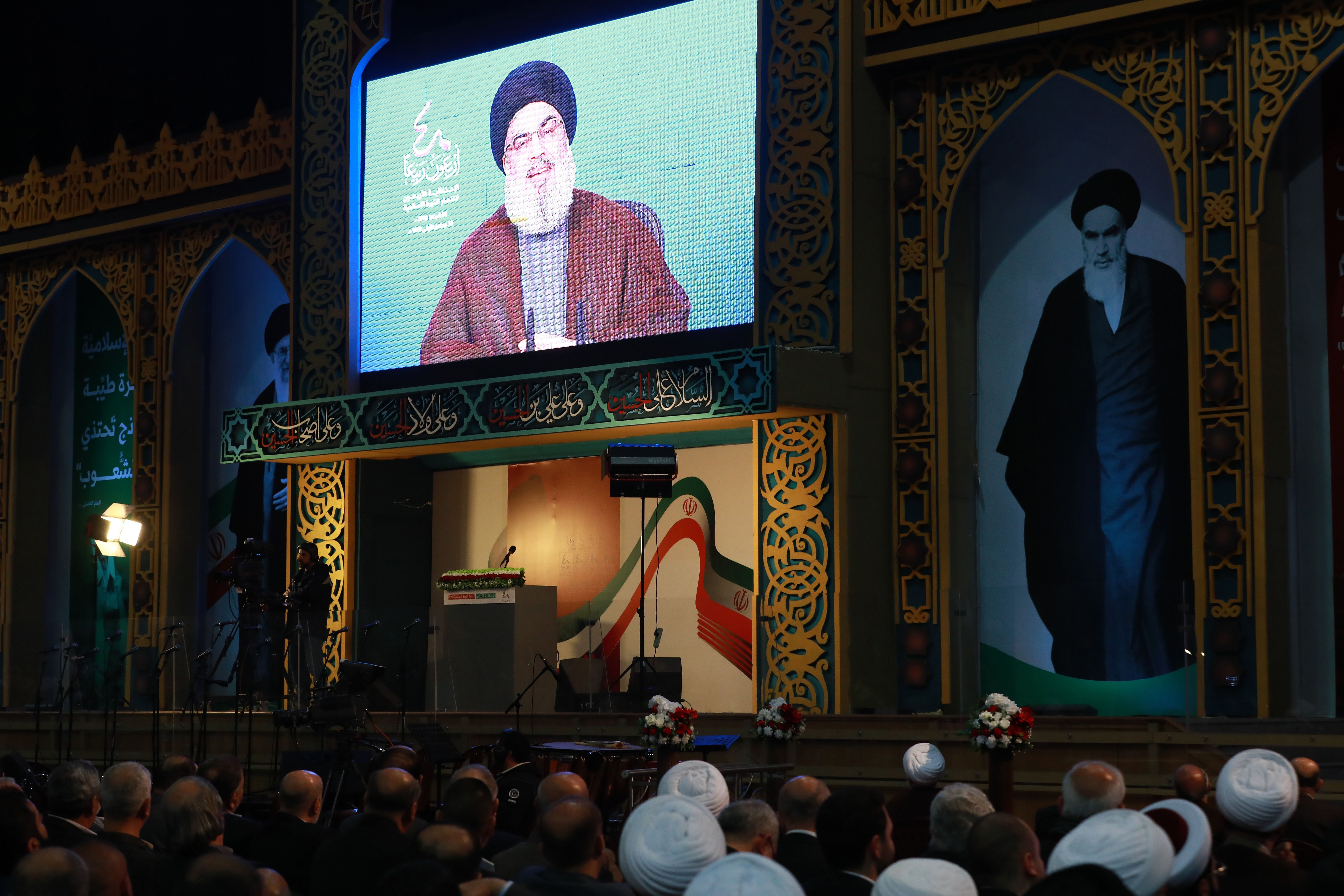 Supporters of Lebanon's Shiite movement Hezbollah listen to a speech by the movement's leader Hassan Nasrallah on a large screen, during celebrations marking the 40th anniversary of the Iranian revolution in the capital Beirut's southern suburbs on February 6, 2019. (Photo by ANWAR AMRO/AFP/Getty Images)