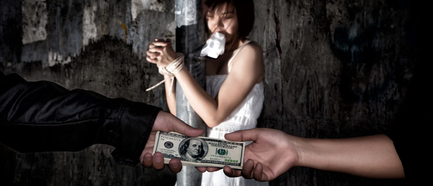 Human Trafficking (Shutterstock/SanchaiRat)