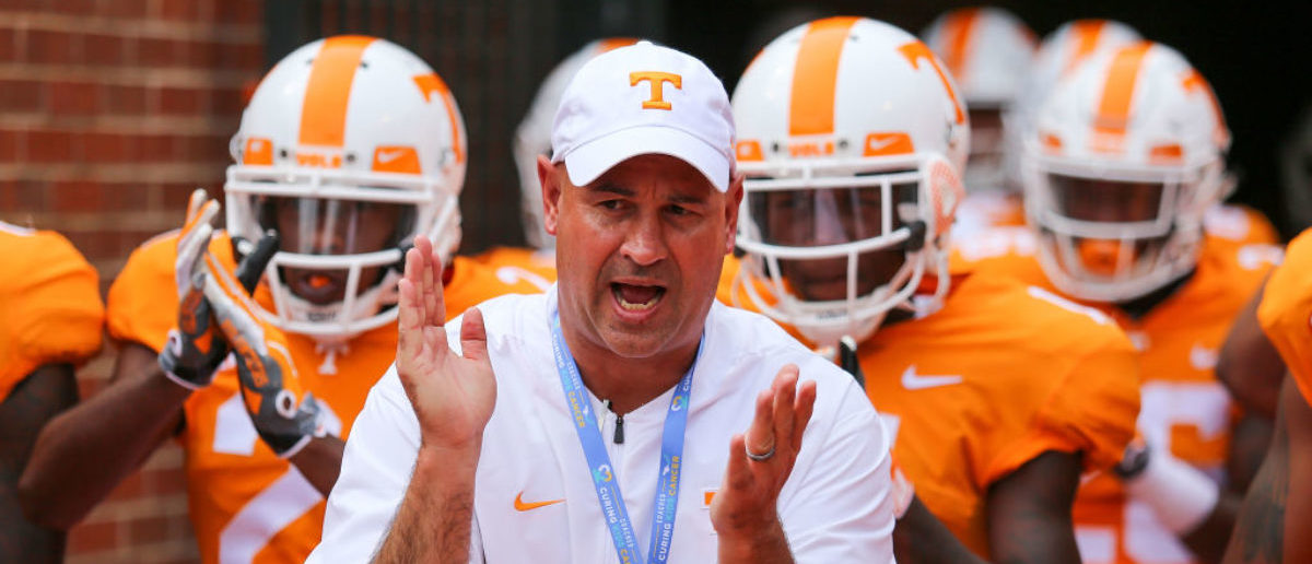 KNOXVILLE, TN - SEPTEMBER 08: Head coach Jeremy Pruitt of the Tennessee Volunteers brings his team onto the field prior to a game against the East Tennessee State University Buccaneers at Neyland Stadium on September 8, 2018 in Knoxville, Tennessee. Tennesee won the game 59-3. (Photo by Donald Page/Getty Images)