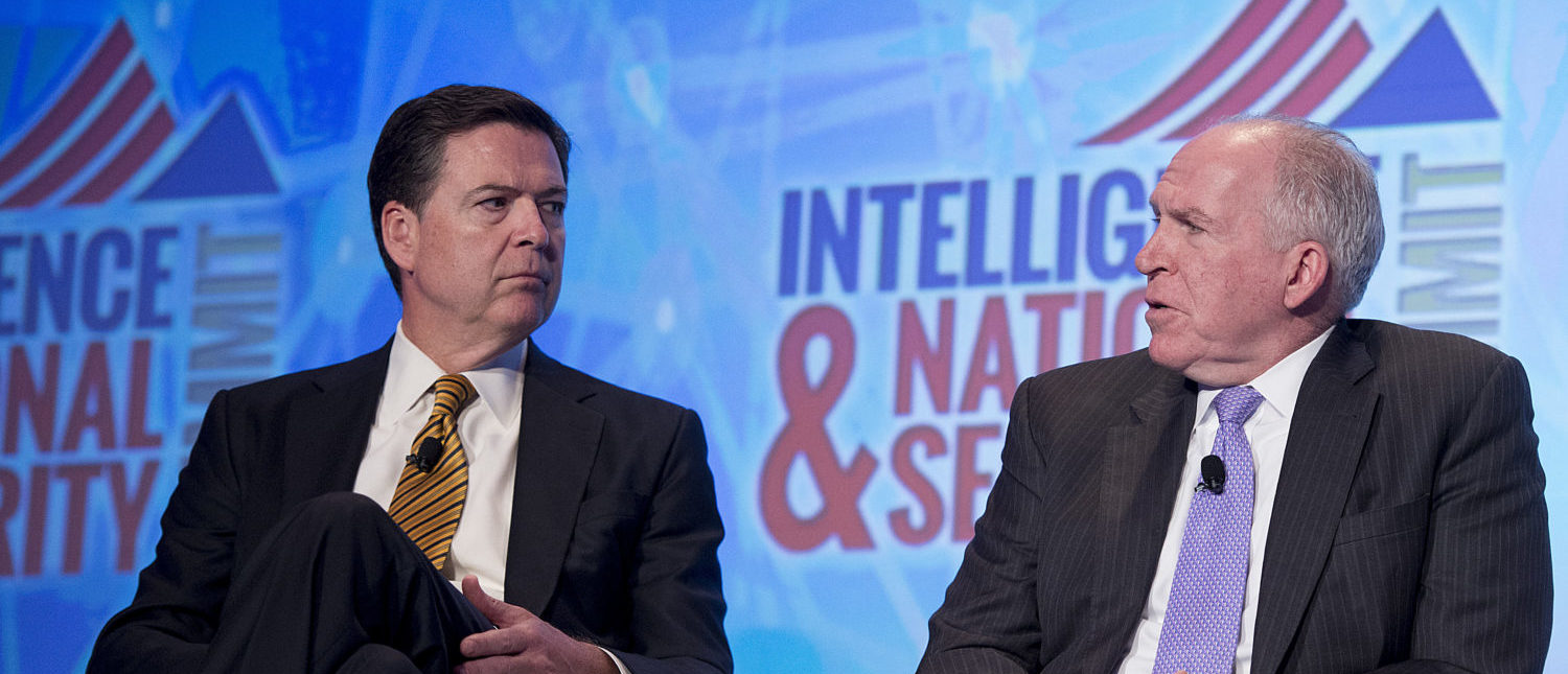 Federal Bureau of Investigation (FBI) Director James Comey (L) and Central Intelligence Agency (CIA) Director John Brennan speak at the 2016 Intelligence and National Security Summit in Washington, DC, September 8, 2016. (Photo: JIM WATSON/AFP/Getty Images)