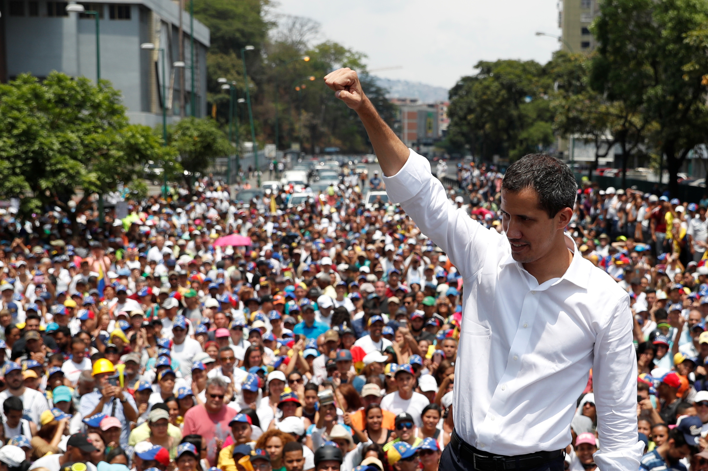 Venezuelan opposition leader Juan Guaido, who many nations have recognised as the country's rightful interim ruler, gestures as he speaks to supporters during a rally against the government of Venezuela's President Nicolas Maduro and to commemorate May Day in Caracas Venezuela, May 1, 2019. REUTERS/Carlos Garcia Rawlins