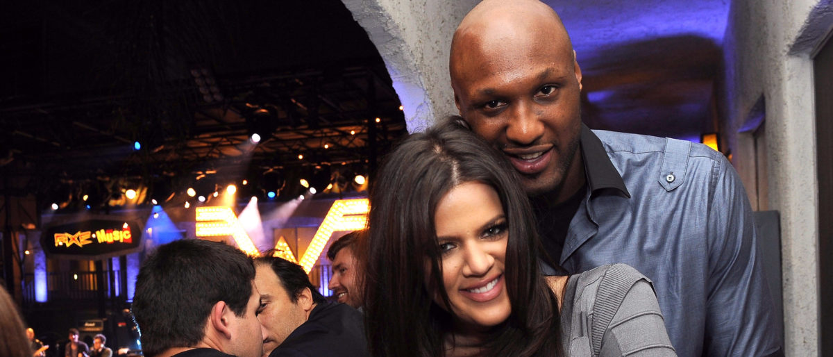 "Television personality Khloe Kardashian (L) and Los Angeles Laker Lamar Odom attend the ""AXE Music One Night Only"" concert series featuring Weezer at Dunes Inn Motel - Sunset on September 21, 2010 in Hollywood, California. (Photo by Michael Buckner/Getty Images For AXE)"