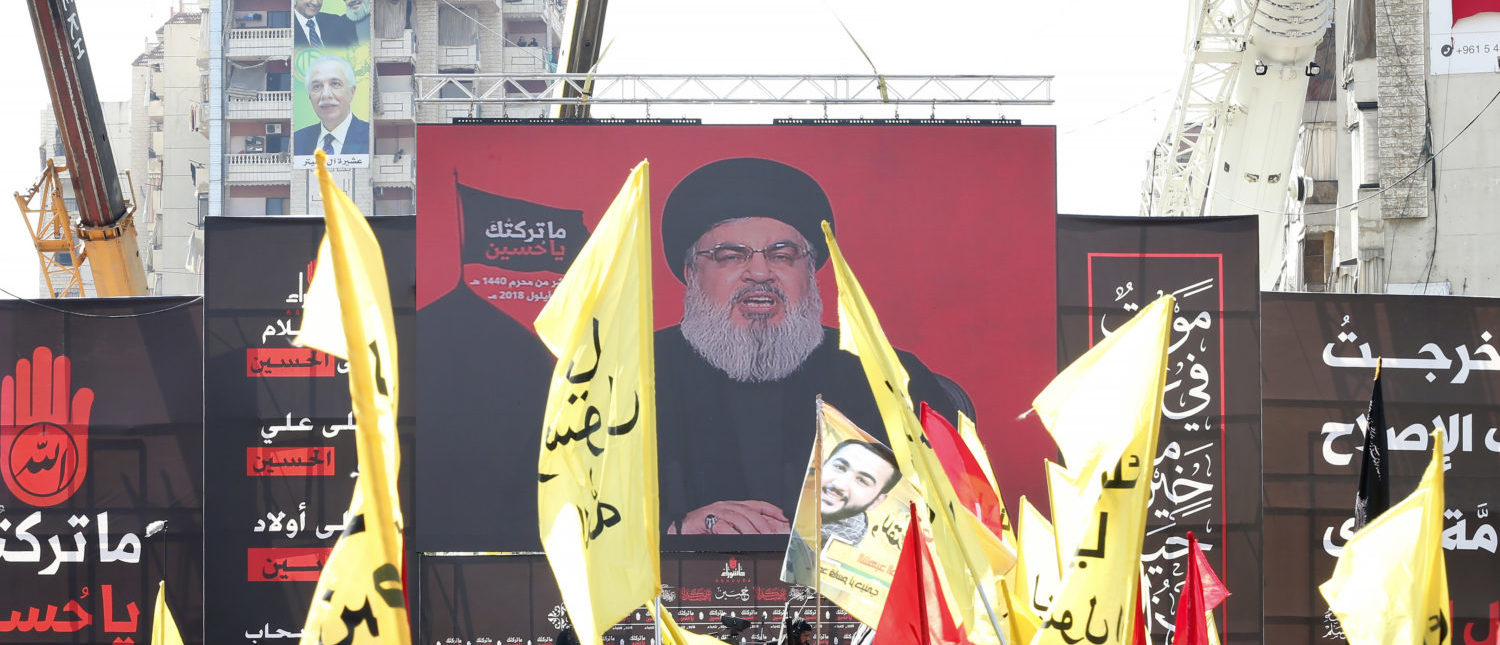 Supporters of Lebanon's Shiite movement Hezbollah gather near a giant poster of their leader Hassan Nasrallah during a ceremony to mark Ashura on Sept. 20, 2018 in Beirut, Lebanon. (Photo by ANWAR AMRO/AFP/Getty Images)