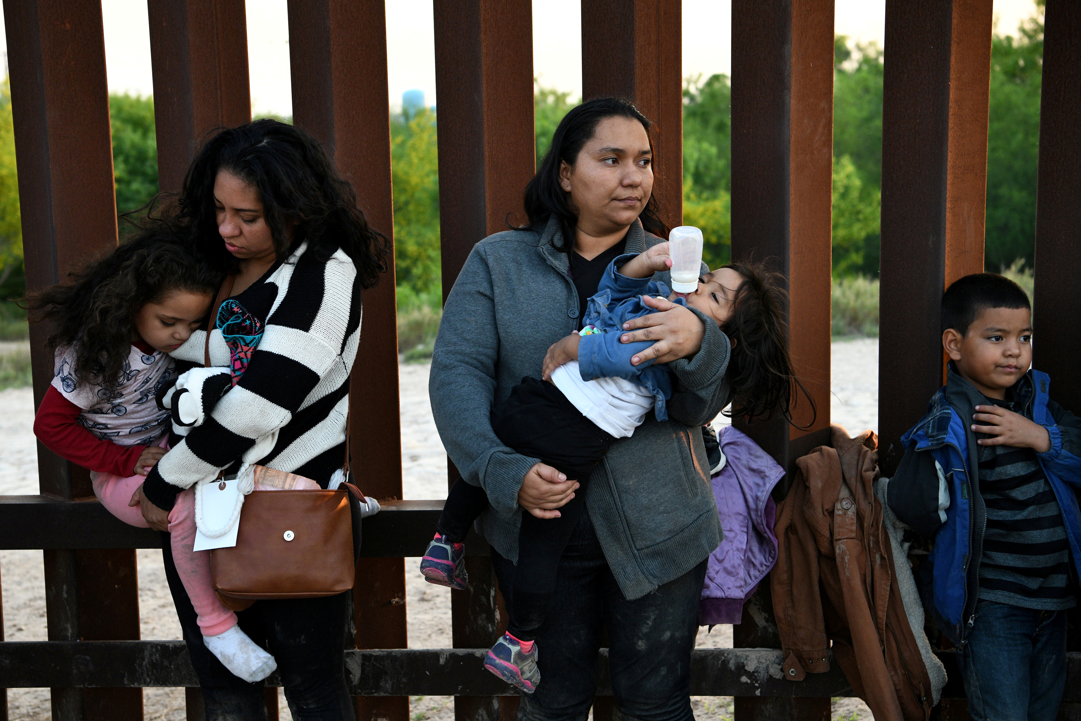 FILE PHOTO: Central American migrants turn themselves in to U.S. Border Patrol as they seek asylum after illegally crossing the Rio Grande near Penitas