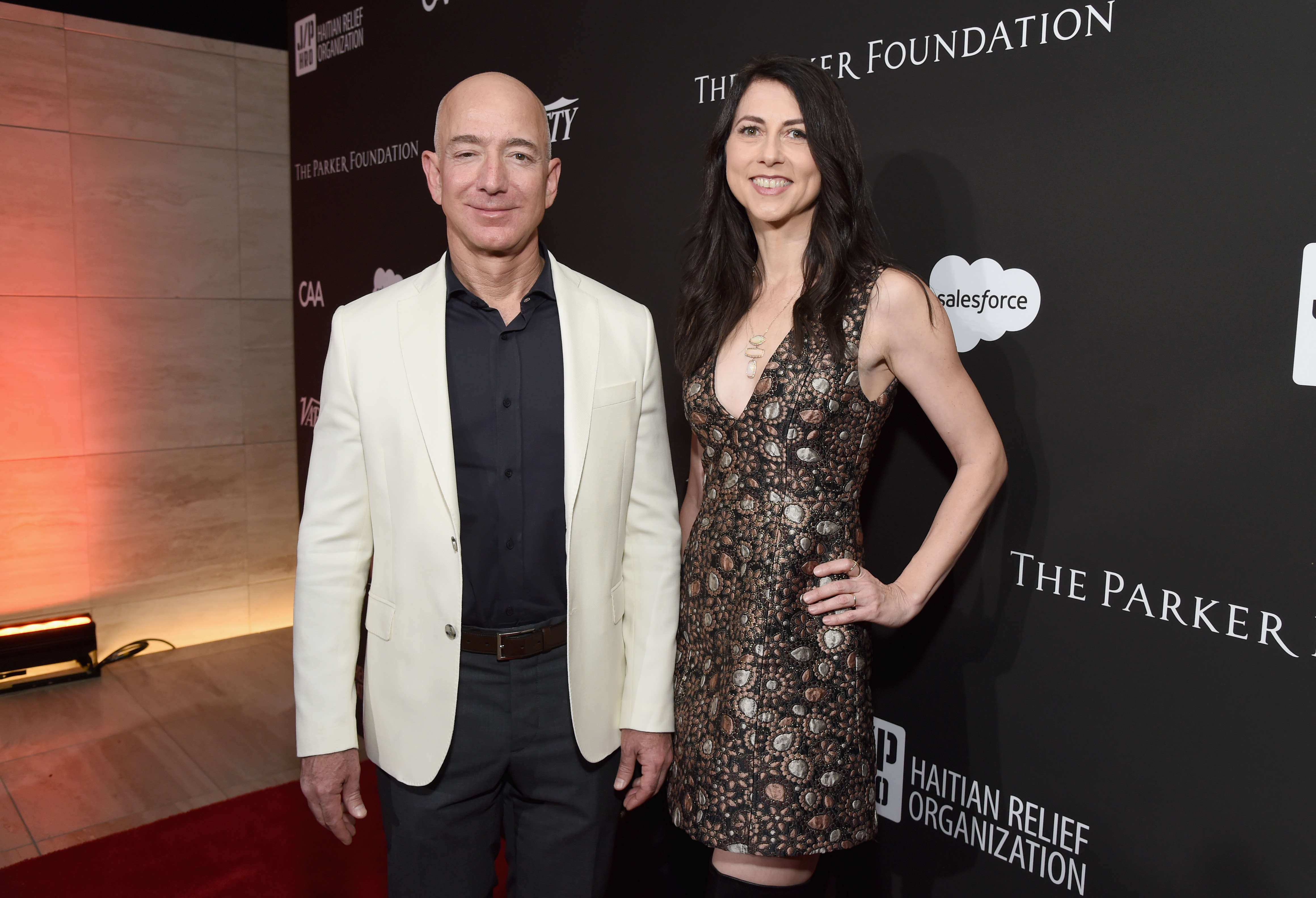 Chief Executive Officer of Amazon Jeff Bezos (L) and MacKenzie Bezos attend the 7th Annual Sean Penn & Friends HAITI RISING Gala benefiting J/P Haitian Relief Organization on January 6, 2018 in Hollywood, California. (Photo by Michael Kovac/Getty Images for for J/P HRO Gala)
