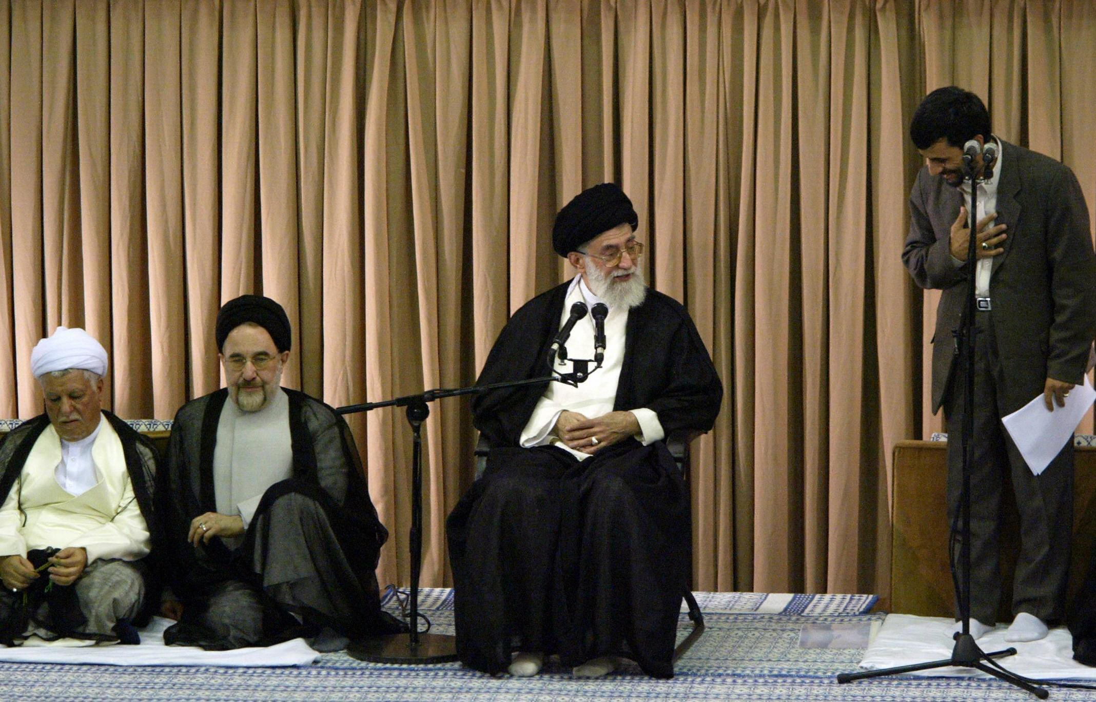 TEHRAN, IRAN: Iran's new President Mahmoud Ahmadinejad, right, Iran's supreme leader Ayatollah Khamenei, center, outgoing President Mohammad Khatami, and former president Ali Akbar Hashami Rafsanjani attend Ahmadinejad's inaugural ceremony in Tehran 03 August 2005. Ahmadinejad appealed for an end to weapons of mass destruction in the world, a day after the West issued sharp warnings to Tehran over its threatened violation of a deal suspending its nuclear programme. AFP PHOTO/ATTA KENARE (Photo credit should read ATTA KENARE/AFP/Getty Images)