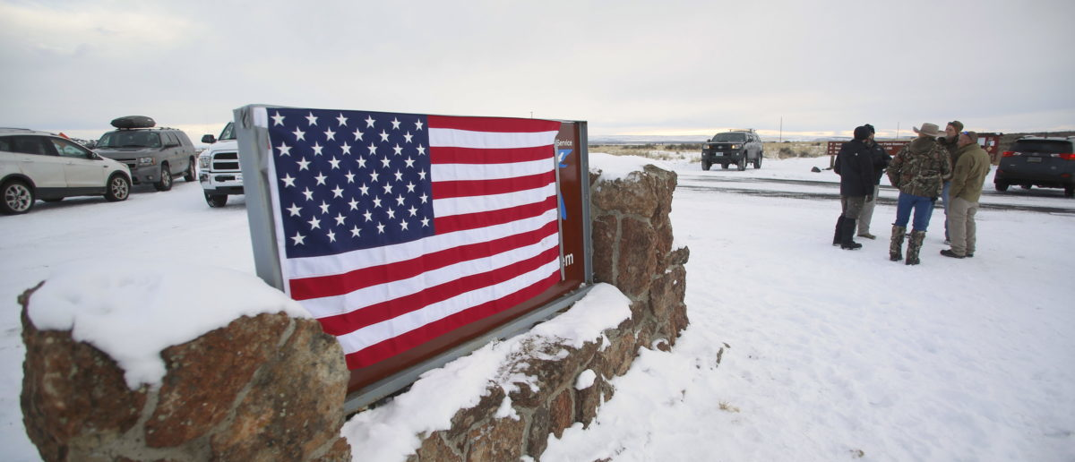 A U.S. flag covers a sign at the entrance of the Malheur National Wildlife Refuge near Burns, Oregon, U.S. January 3, 2016. REUTERS/Jim Urquhart