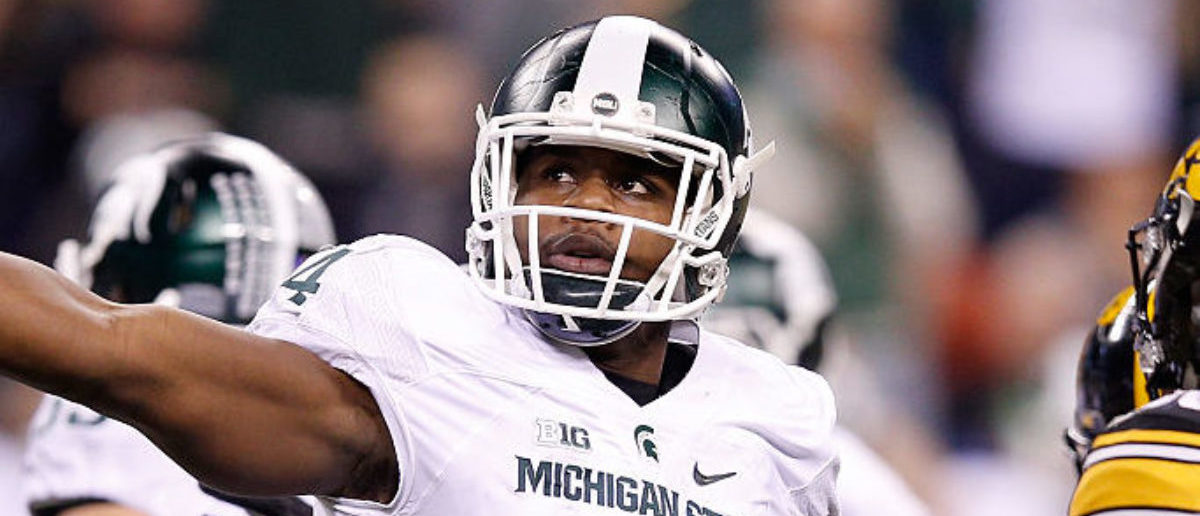 INDIANAPOLIS, IN - DECEMBER 05: Malik McDowell #4 of the Michigan State Spartans reacts during the game against the Iowa Hawkeyes in the Big Ten Championship at Lucas Oil Stadium on December 5, 2015 in Indianapolis, Indiana. (Photo by Joe Robbins/Getty Images)