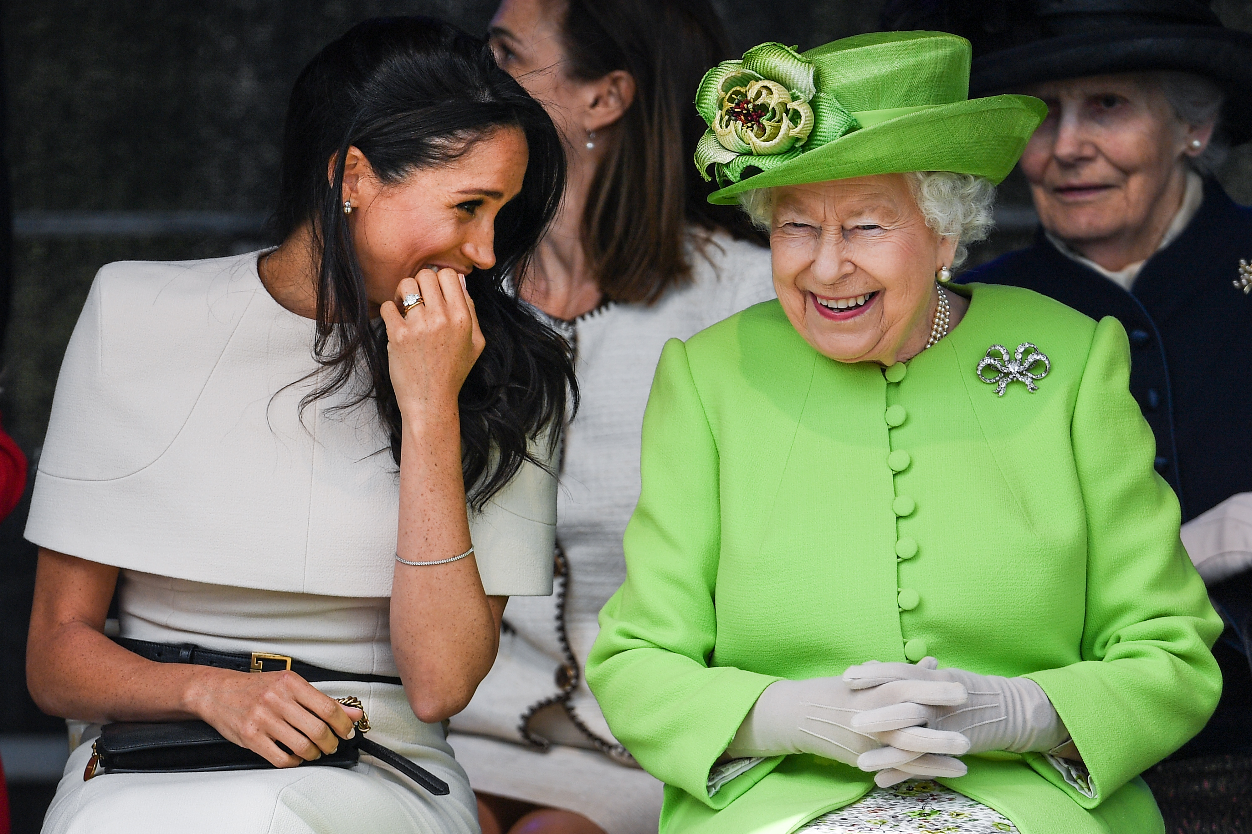Queen Elizabeth II sitts and laughs with Meghan, Duchess of Sussex during a ceremony to open the new Mersey Gateway Bridge on June 14, 2018 in the town of Widnes in Halton, Cheshire, England. Meghan Markle married Prince Harry last month to become The Duchess of Sussex and this is her first engagement with the Queen. During the visit the pair will open a road bridge in Widnes and visit The Storyhouse and Town Hall in Chester. (Photo by Jeff J Mitchell/Getty Images)
