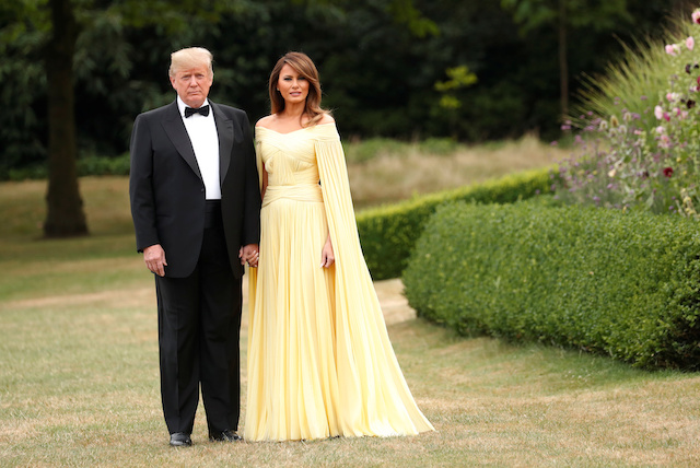 U.S. President Donald Trump and the first Lady Melania Trump leave the U.S. ambassador's residence, Winfield House, on their way to Blenheim Palace for dinner with Britain's Prime Minister Theresa May and business leaders, in London, Britain, July 12, 2018. REUTERS/Kevin Lamarque