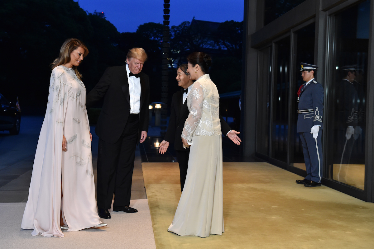US President Donald Trump (2nd L) and First Lady Melania Trump (L) are greeted by Japan's Emperor Naruhito and Empress Masako upon their arrival at the Imperial Palace for a state banquet on May 27, 2019 in Tokyo, Japan. (Photo by Kazuhiro Nogi - Pool/Getty Images)