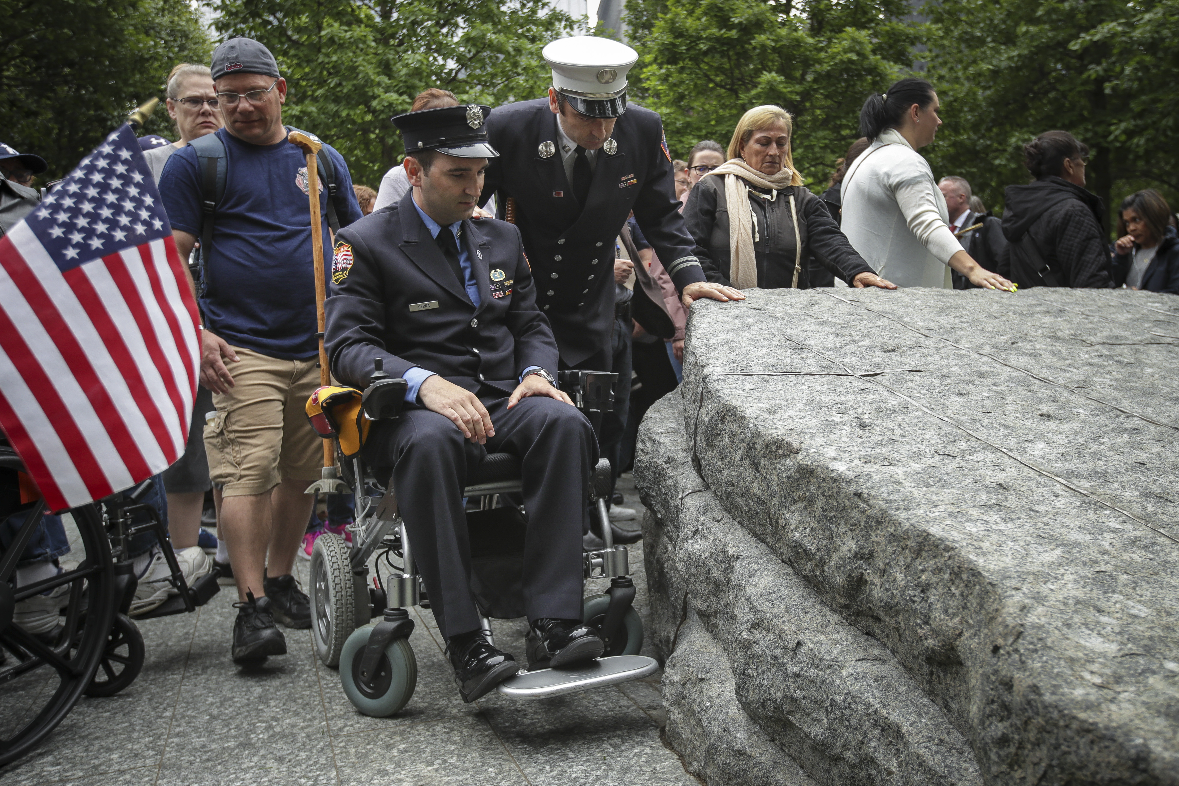 NEW YORK, NY - MAY 30: Retired FDNY firefighter and 9/11 first responder Rob Serra pauses at one of the stone monoliths following the dedication ceremony for the new 9/11 Memorial Glade at the National September 11 Memorial, May 30, 2019 in New York City. The 9/11 Memorial Glade honors the first responders who are sick or have died from exposure to toxins in the aftermath of the attacks and recovery efforts. The signature piece of the memorial are six stone monoliths that are inlaid with World Trade Center steel. (Photo by Drew Angerer/Getty Images)