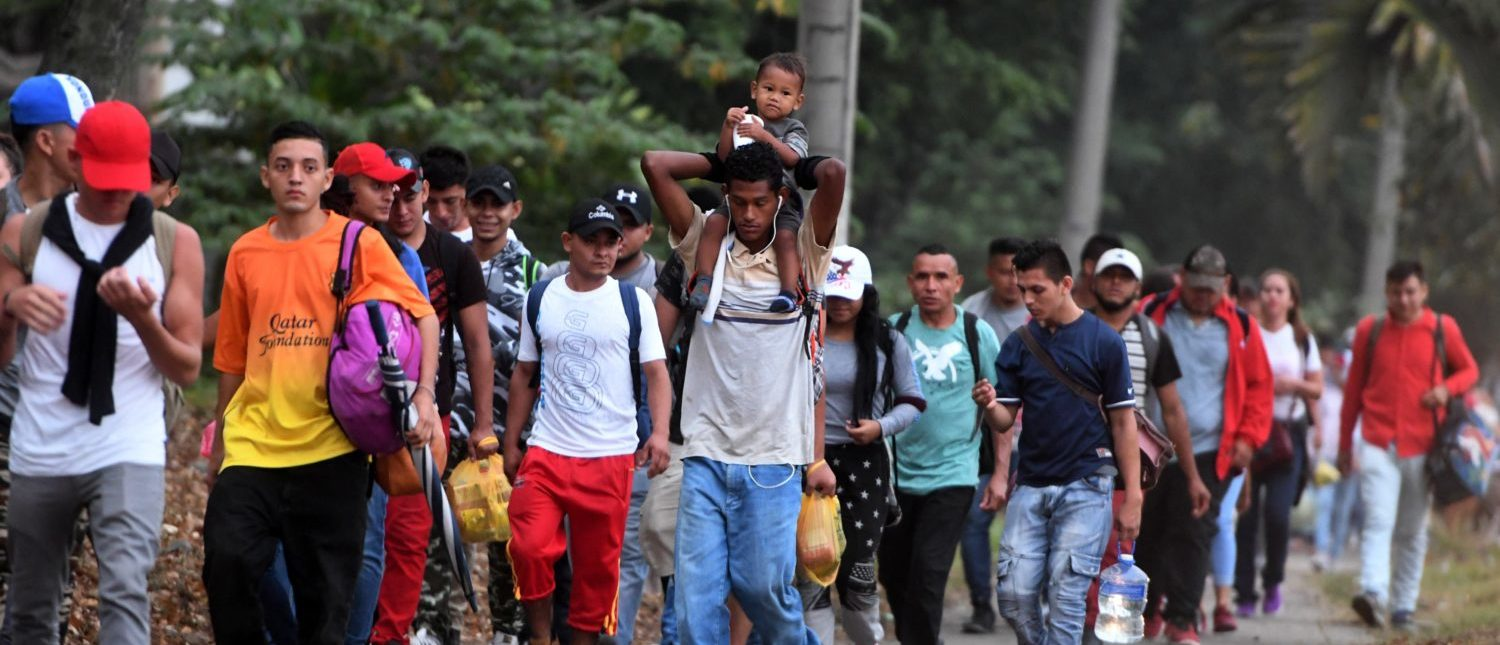 Honduran migrants leave the Metropolitan Center of San Pedro Sula, 300 kms north of Tegucigalpa, to travel to the Guatemala border on April 10, 2019. - Almost 1,000 people gathered Tuesday night in the town of San Pedro Sula in northern Honduras to form a new caravan to reach the United States, police said. Since October 13, when the first caravan of 2,000 set off, three other similar convoys of migrants have left Honduras for the US in search of work or fleeing drug-traffickers. (Photo by ORLANDO SIERRA / AFP) (Photo credit should read ORLANDO SIERRA/AFP/Getty Images)