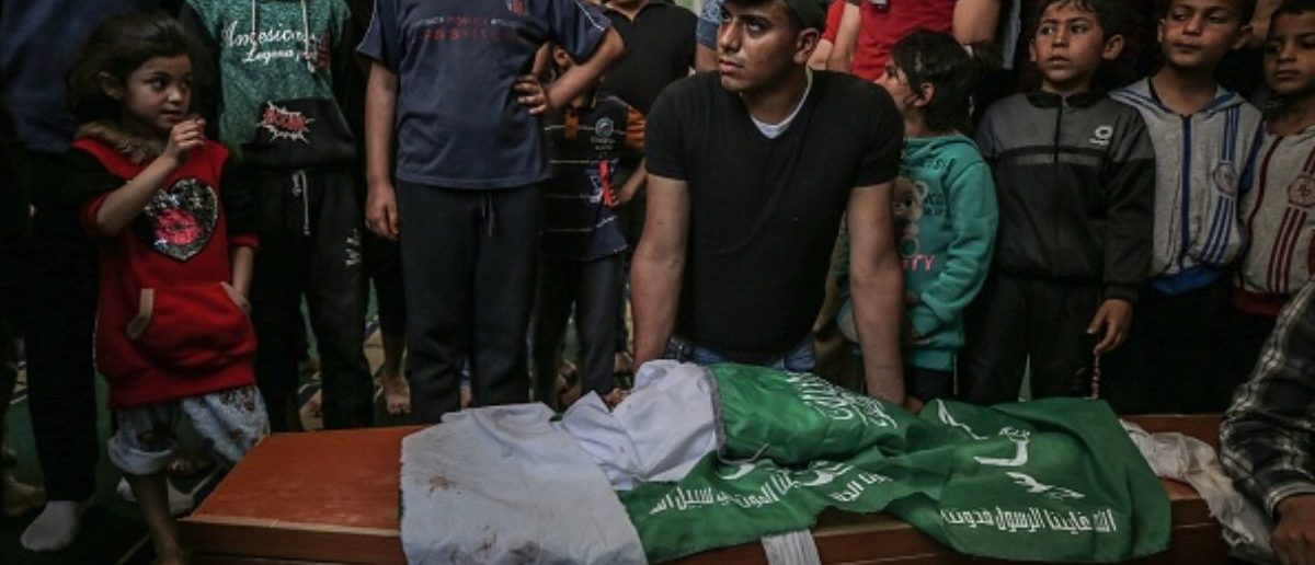 GAZA CITY, GAZA - MAY 6: (EDITOR'S NOTE: Image depicts death) Palestinians are seen near the dead body of 4 month of Palestinian baby Maria who was killed by Israeli airstrikes on Gaza, during his funeral ceremony in Gaza City, Gaza on May 6, 2019. (Photo by Ali Jadallah/Anadolu Agency/Getty Images)