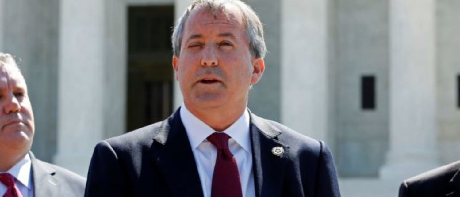 Texas Attorney General Ken Paxton (C) holds a news conference to announce Texas and 20 other states have filed a lawsuit against the state of Delaware over millions of dollars in unclaimed official checks Paxton says have wrongly been remitted to Delaware, at the Supreme Court building in Washington, U.S. June 9, 2016. REUTERS/Jonathan Ernst