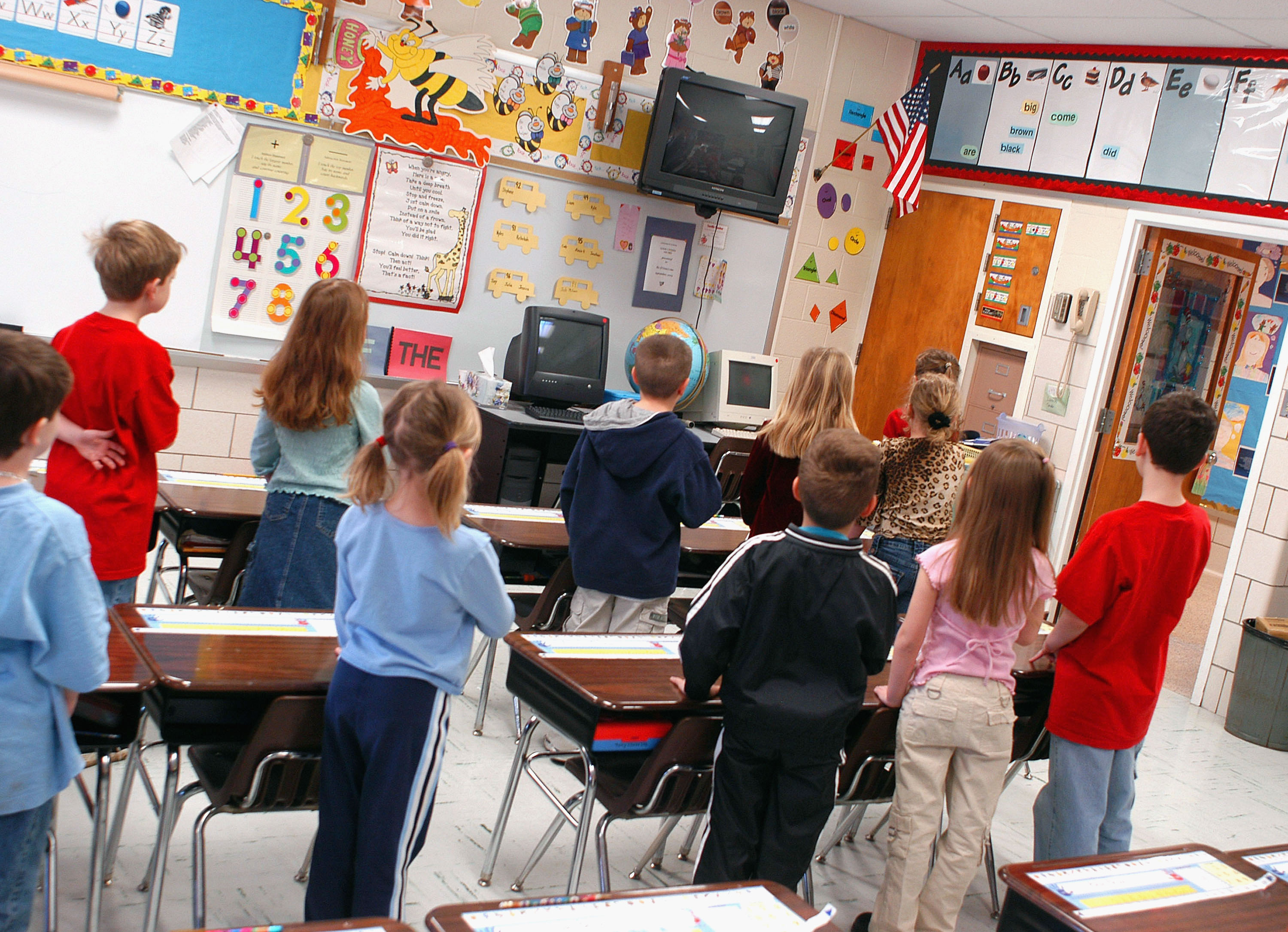 WARMINSTER, PA - MARCH 24: First graders at Longstreth Elementary School pledge allegiance to the flag March 24, 2004 in Warminster, Pennsylvania. (Photo by William Thomas Cain/Getty Images)
