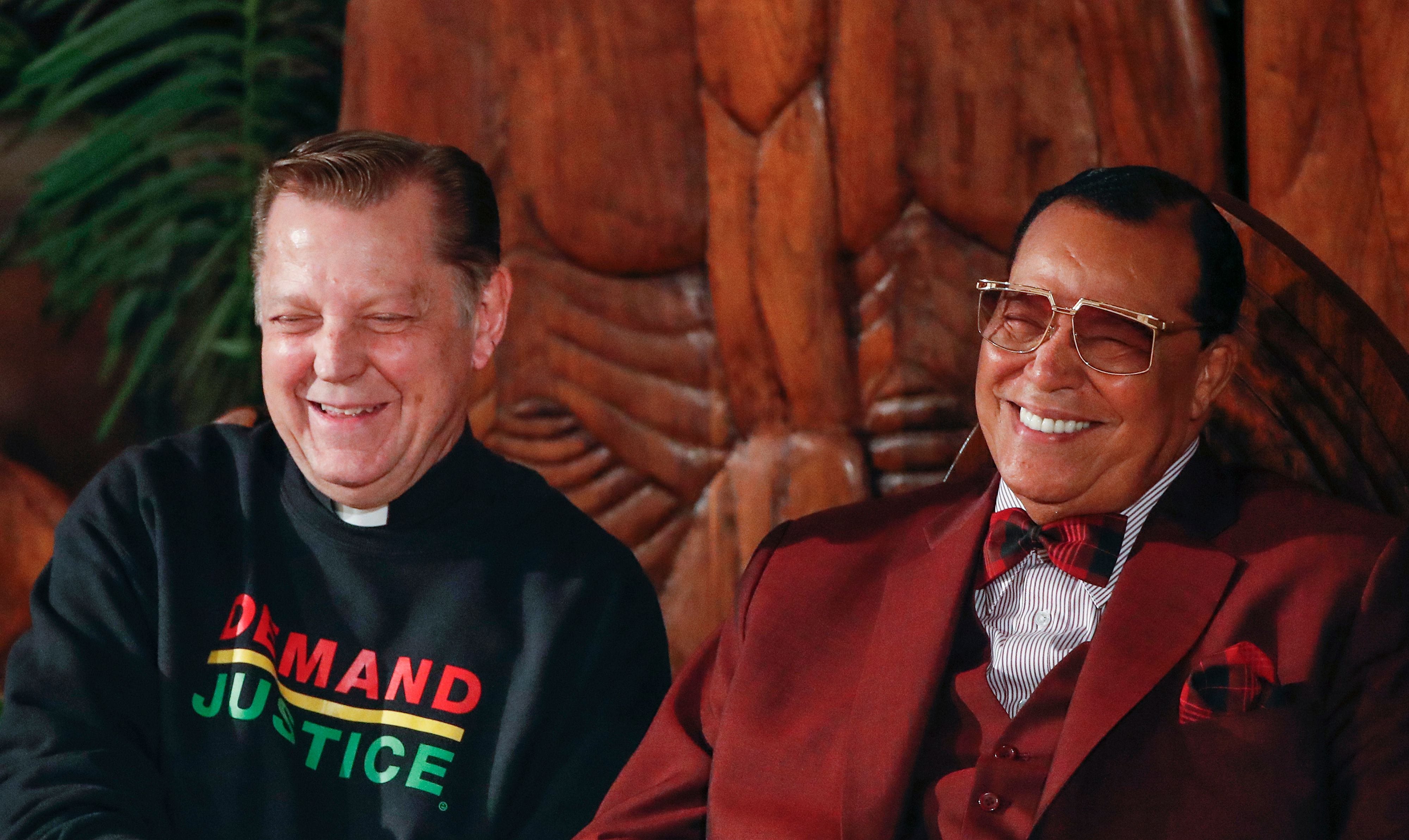 Father Michael Pfleger (L) shares a laugh with Nation of Islam leader Louis Farrakhan (R) during an event regarding his ousting from Facebook, at St. Sabina Catholic Church in Chicago, Illionis on May 9, 2019. (KAMIL KRZACZYNSKI/AFP/Getty Images)