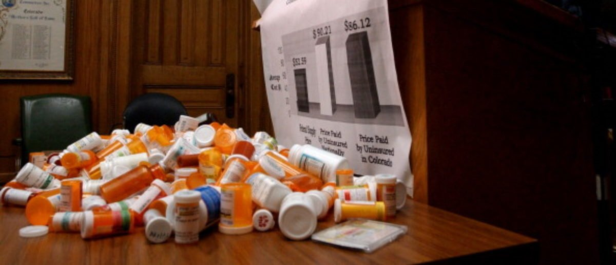 01_26_04_DENVER, CO- The increase in prescription drug costs is forcing many Americans to go without critical medication. It is also forcing states to implement policies to help citizens afford the drugs they need. Representative John Salazar (D-Manassa) wants to make Colorado a national leader in curbing drug costs . Salazar's House Bill 1128 , co-sponsored by Senator Ken Kester (R-Las Animas) , is a bi-partisan solution that lowers costs through bulk purchasing agreements . Salazar and Kester, along with representatives from AARP and CoPIRG , held a news conference today to discuss the bill . The press conference was held at the Capitol . ABOVE: Representative John Salazar , right, addresses the media. He stands in front of a pile of empty presrciption bottles. PHOTO BY HELEN H. RICHARDSON (Photo By Helen H. Richardson/The Denver Post via Getty Images)