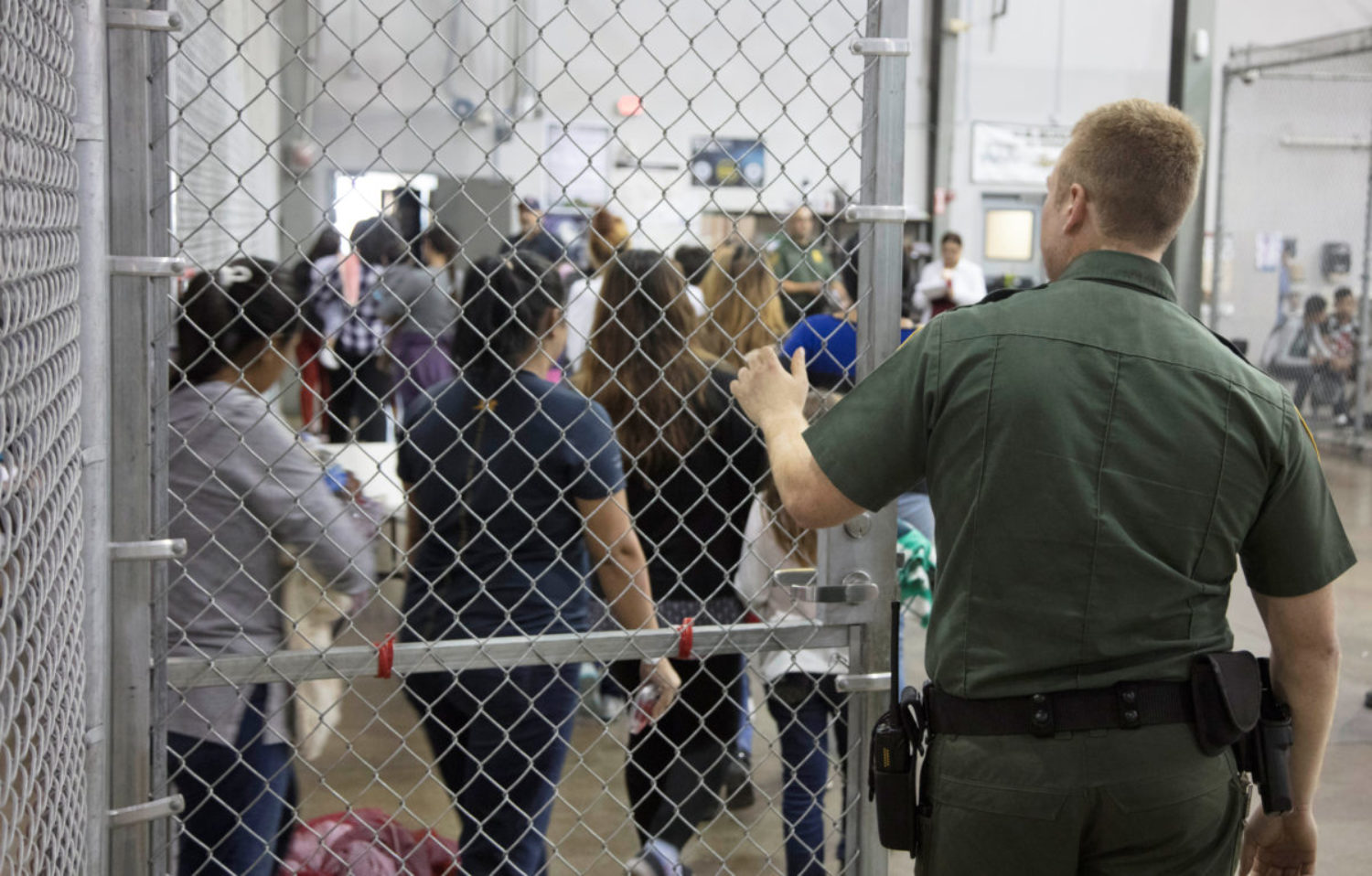 A view of inside CBP detention facility shows detainees inside fenced areas at Rio Grande Valley Centralized Processing Center in Texas