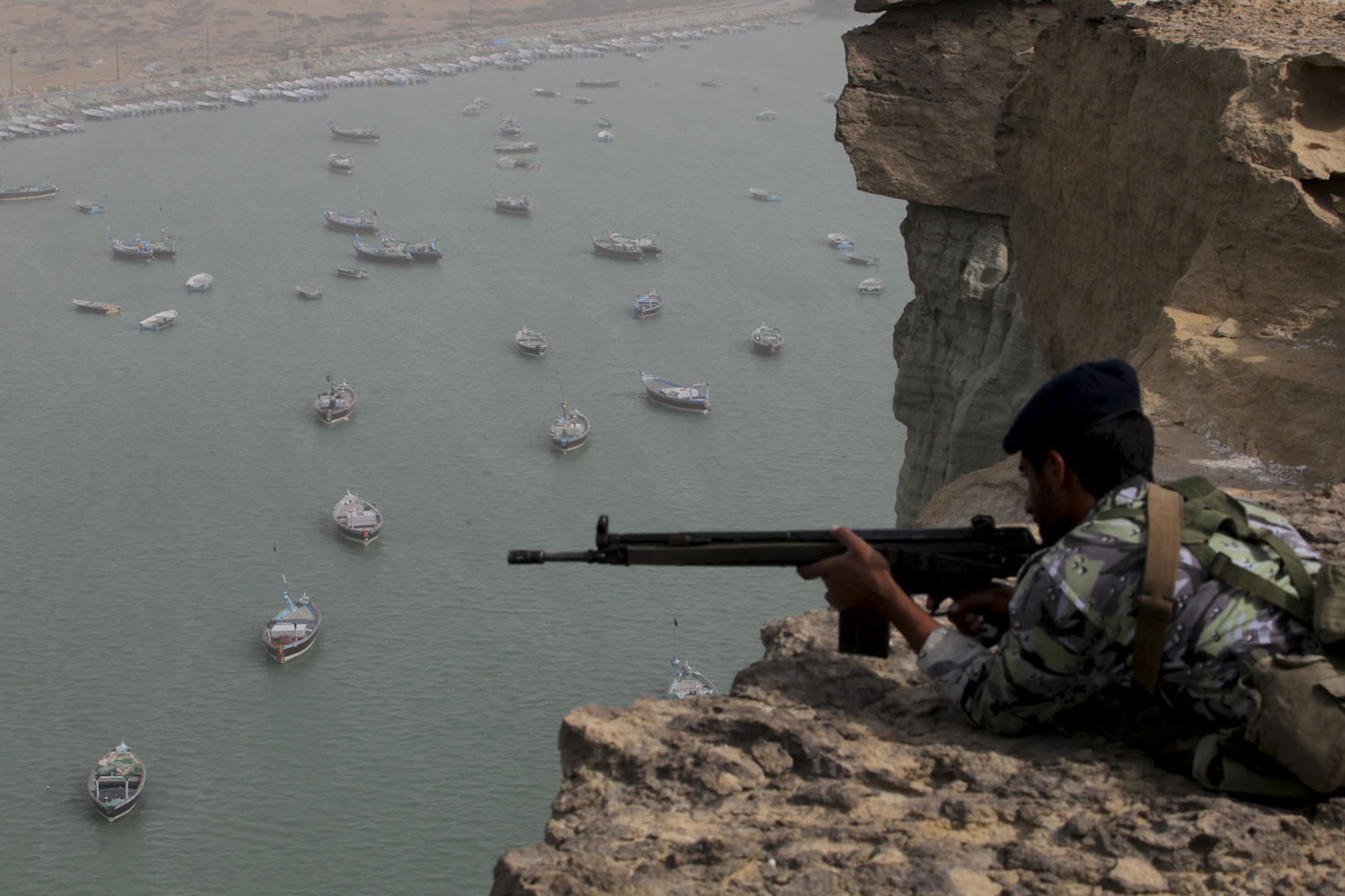 Iranian military personnel participate in Velayat-90 war game in unknown location near Strait of Hormuz in southern Iran