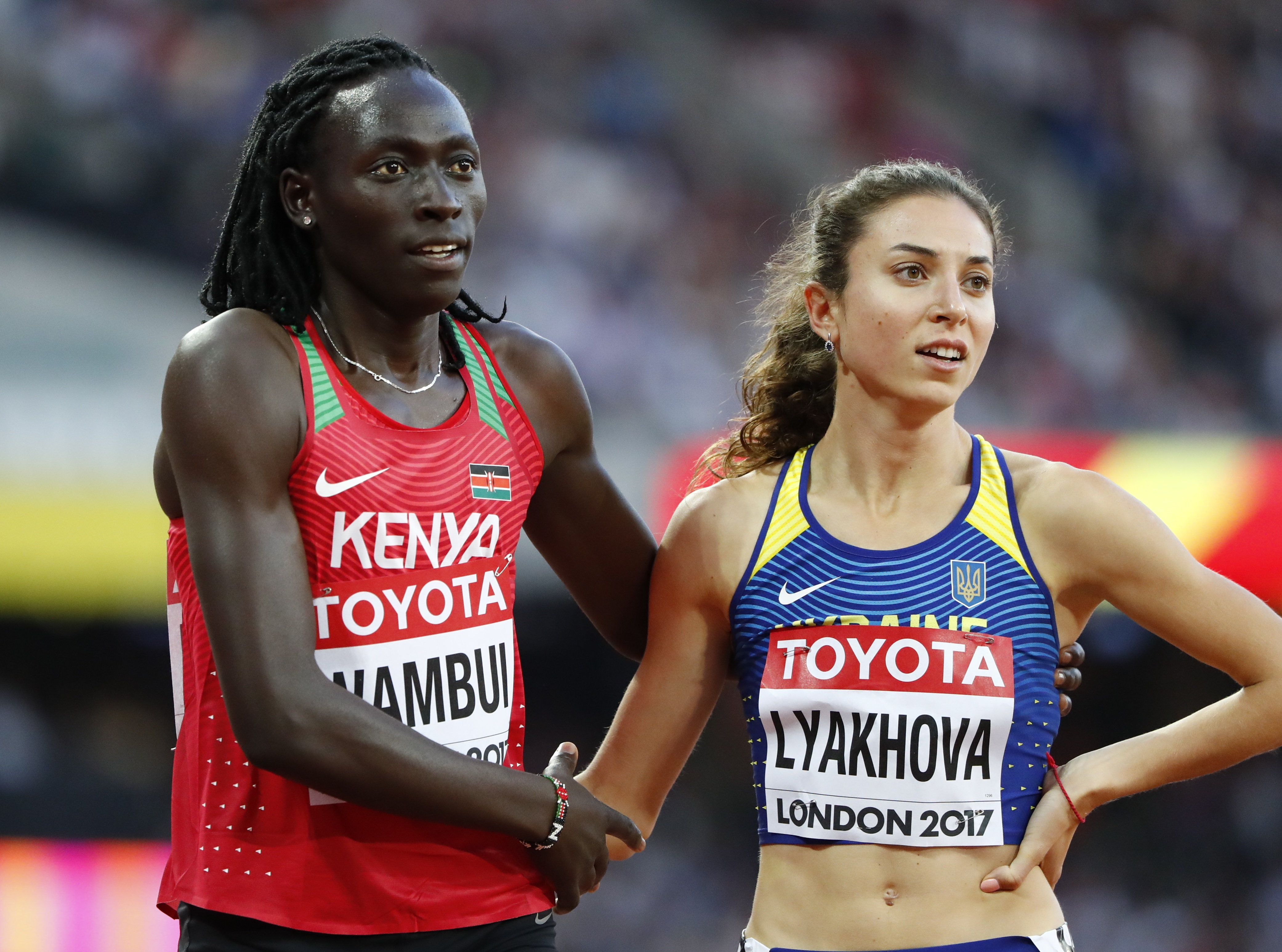 Athletics - World Athletics Championships – Women's 800 metres heats – London Stadium, London, Britain – August 10, 2017 – Margaret Wambui of Kenya and Olha Lyakhova of Ukraine REUTERS/Lucy Nicholson