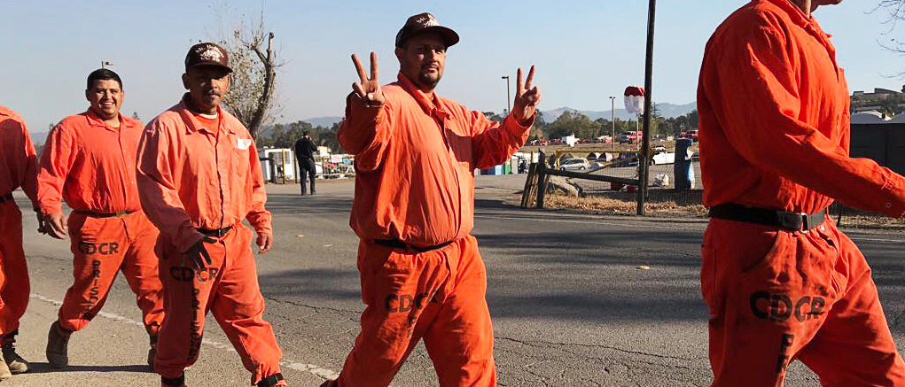 Prison inmates head out to the days work of battling the blazes at fire command center in Santa Rosa, California, U.S October 14, 2017. REUTERS/Heather Somerville.
