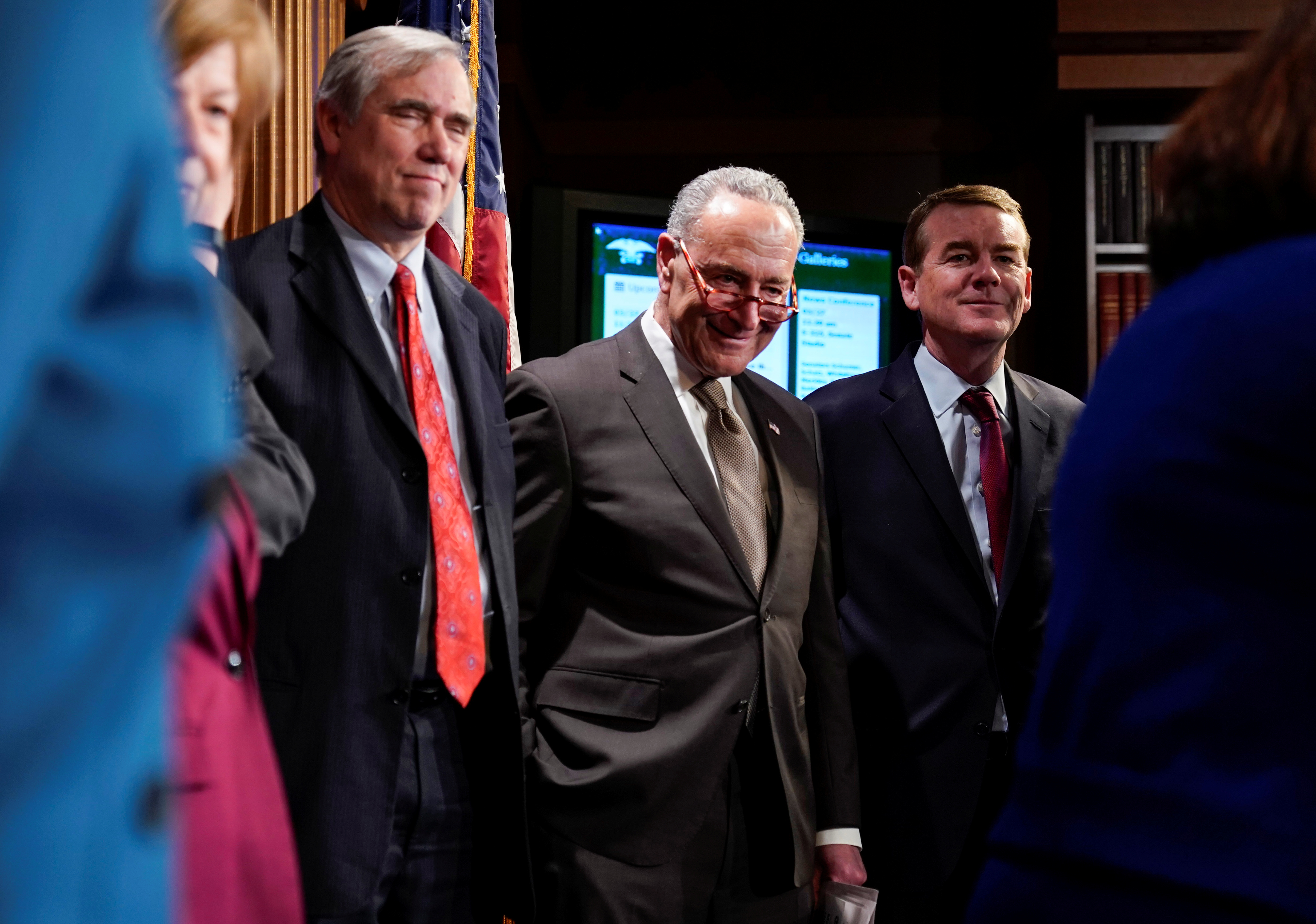 Senate Minority Leader Schumer stands with Senators Merkley and Bennett during Senate Democrats' Special Committee on Climate Change announcement in Washington