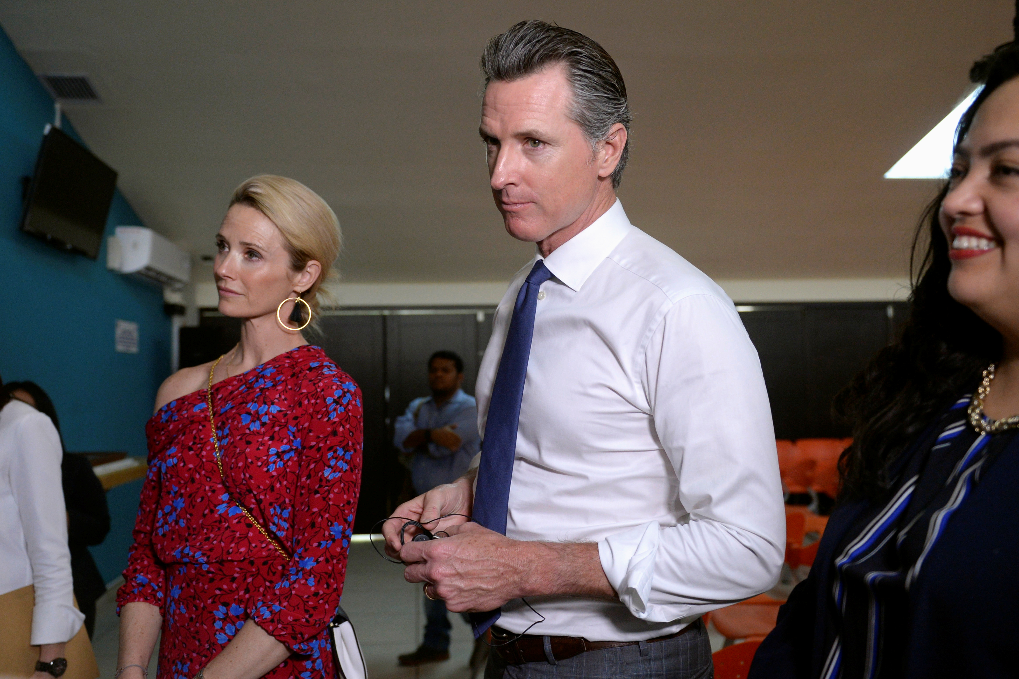 Governor of U.S. state of California Gavin Newsom and his wife Jennifer Siebel Newsom visit the premises of a migrant assistance office in San Salvador
