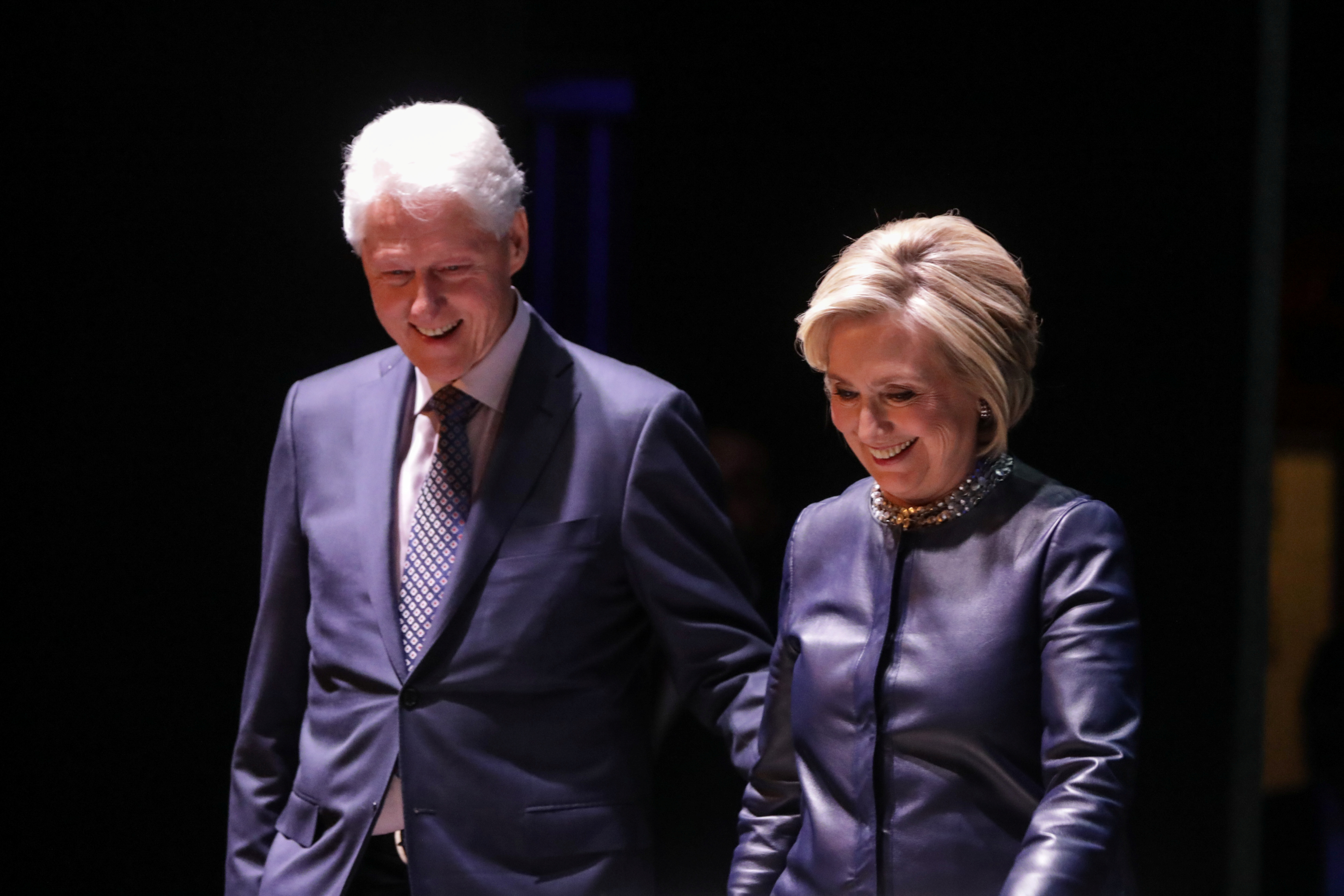 Former Secretary of State Hillary Clinton and former President Bill Clinton appear together during a joint on stage conversation event at the Beacon Theatre in New York, U.S., April 11, 2019. REUTERS/Stephen Yang